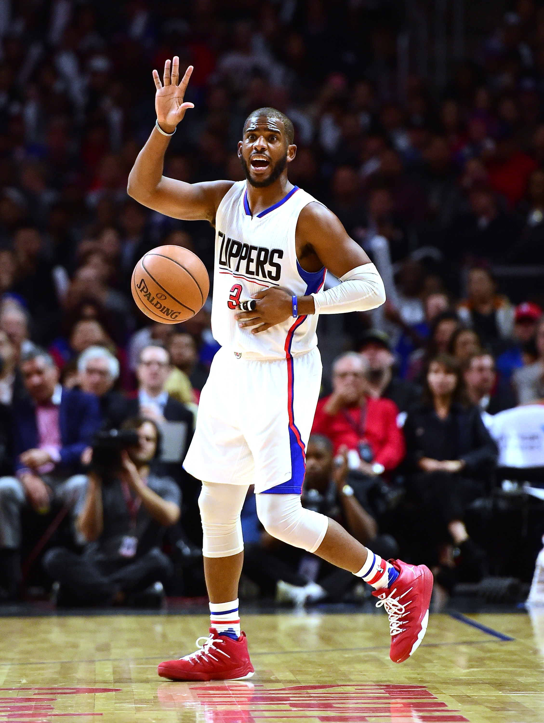 LOS ANGELES, CA - NOVEMBER 30:  Chris Paul #3 of the Los Angeles Clippers calls a play during a 102-87 Clipper win over the Portland Trail Blazers at Staples Center on November 30, 2015 in Los Angeles, California.  (Photo by Harry How/Getty Images)