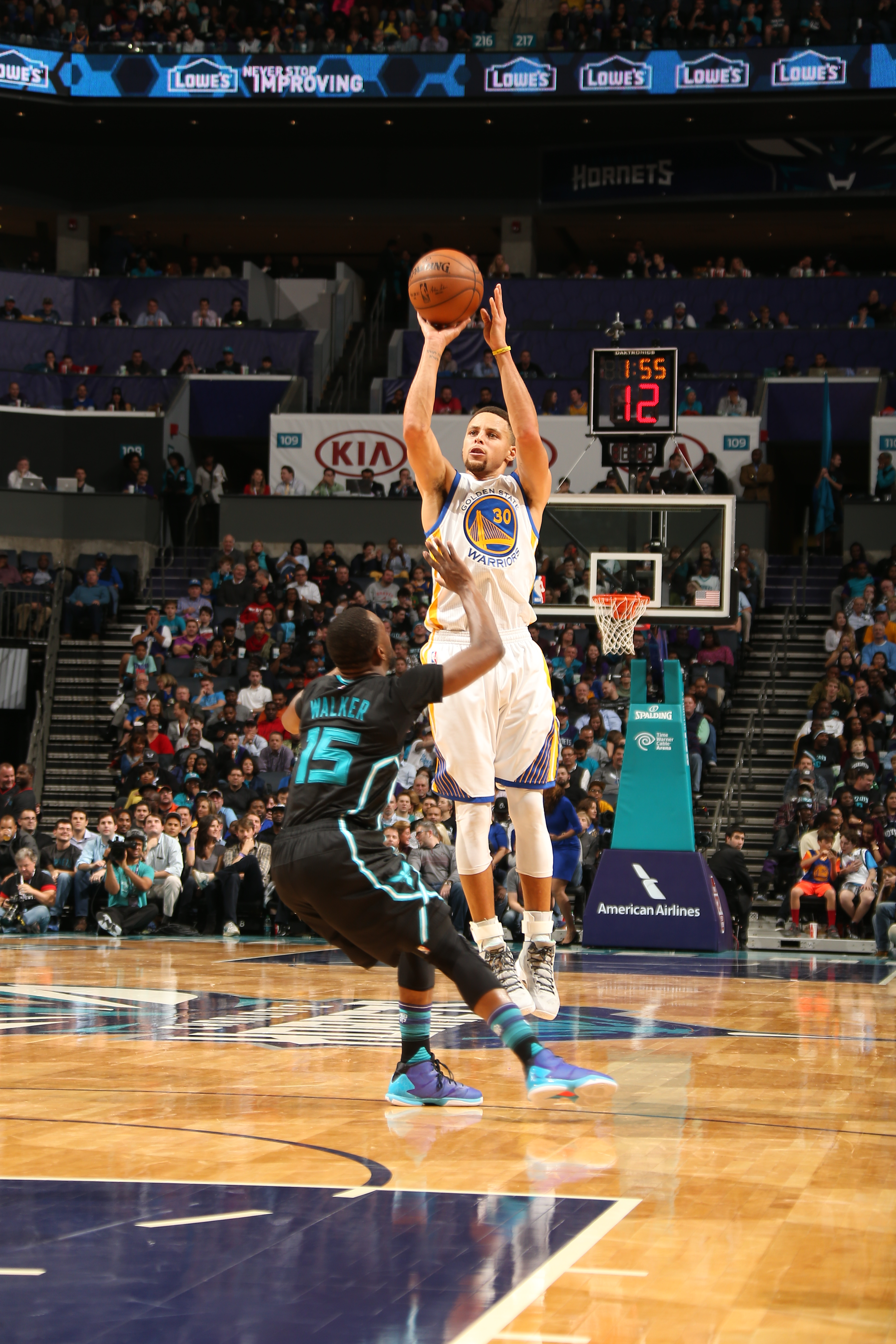 CHARLOTTE, NC - DECEMBER 2:  Stephen Curry #30 of the Golden State Warriors shoots the ball against the Charlotte Hornets on December 2, 2015 at Time Warner Cable Arena in Charlotte, North Carolina. (Photo by Kent Smith/NBAE via Getty Images)