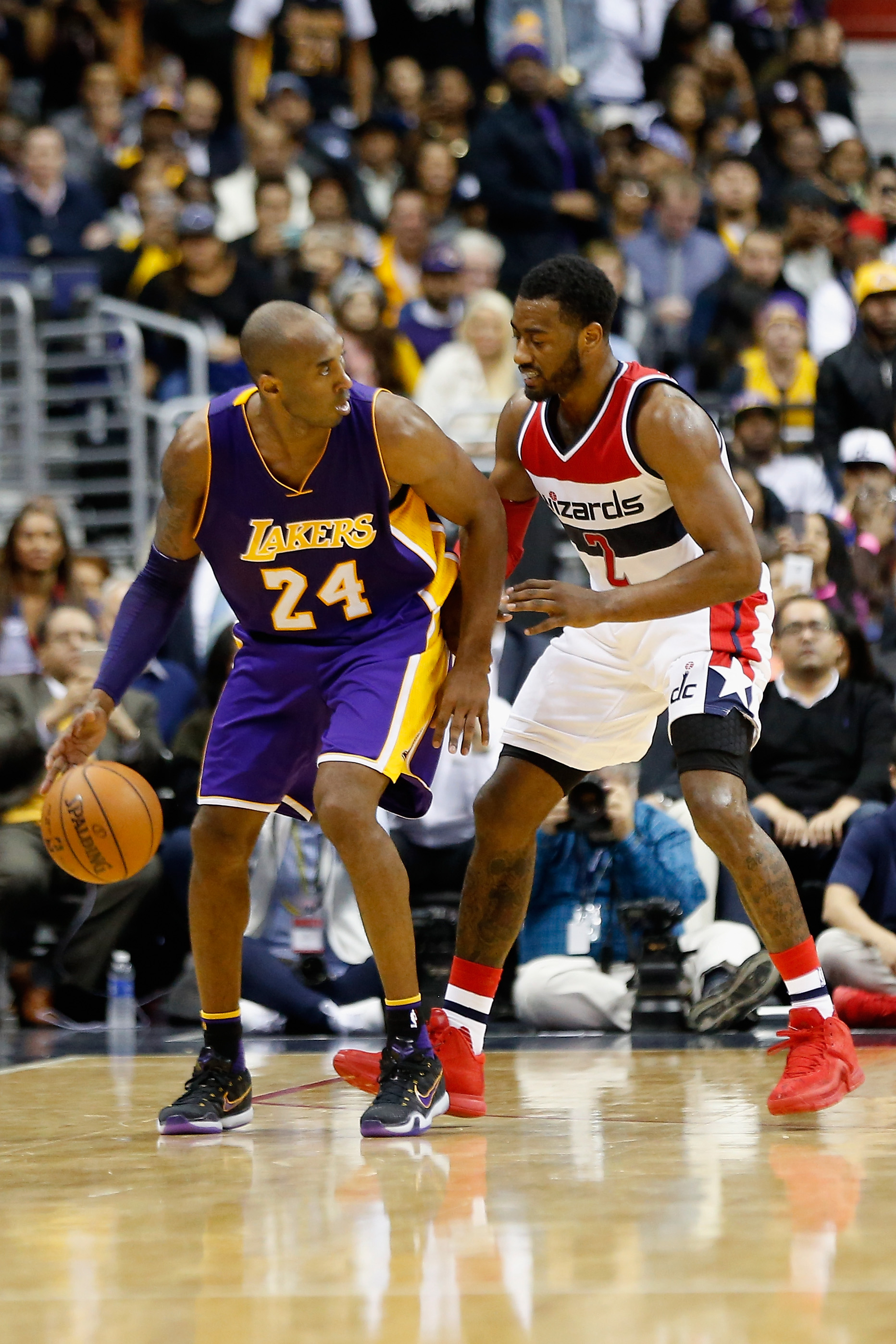 WASHINGTON, DC - DECEMBER 02:  Kobe Bryant #24 of the Los Angeles Lakers dribbles the ball against John Wall #2 of the Washington Wizards in the second half of the Lakers 108-104 win at Verizon Center on December 2, 2015 in Washington, DC.  (Photo by Rob