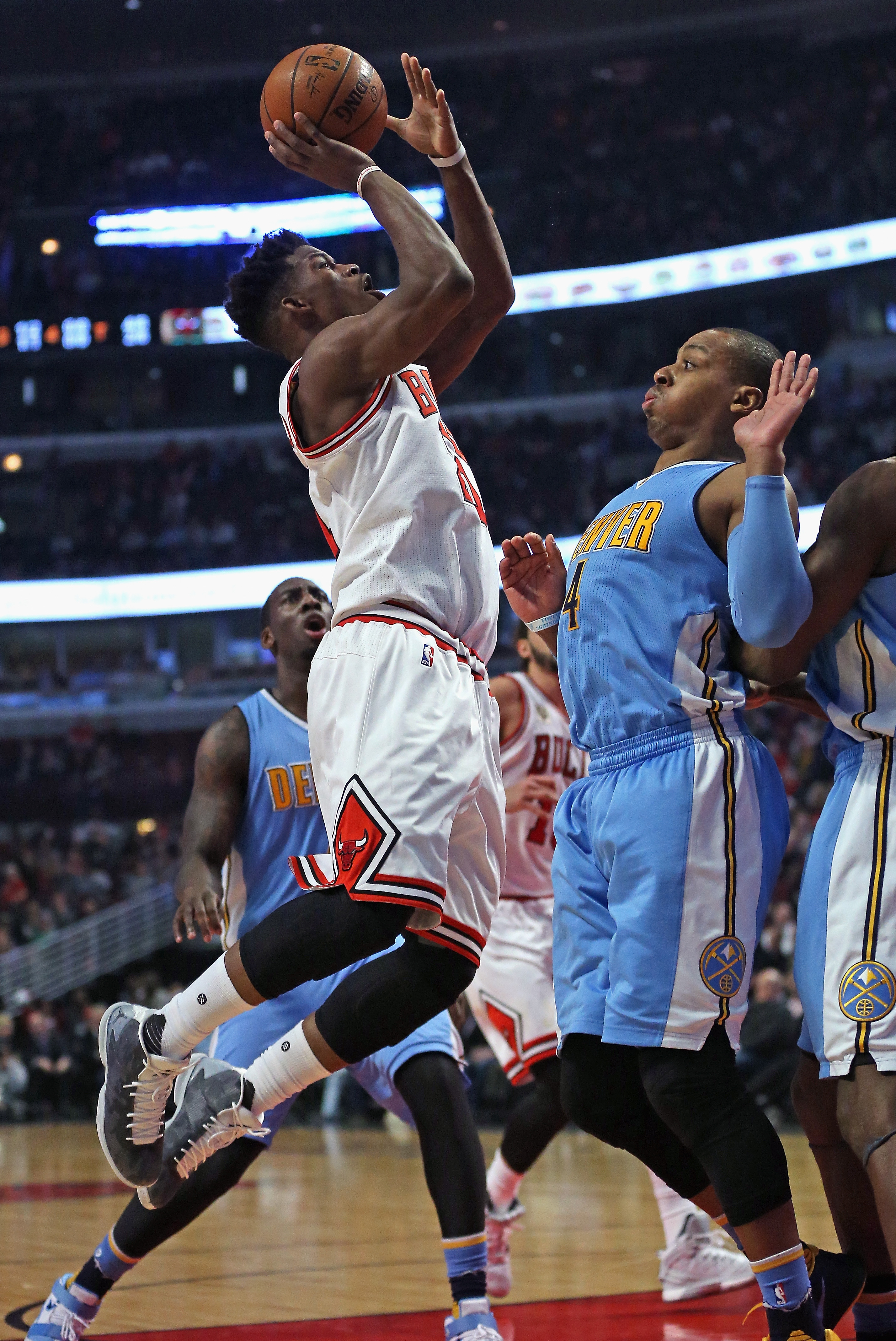 CHICAGO, IL - DECEMBER 02: Jimmy Butler #21 of the Chicago Bulls shoots over Randy Foye #4 of the Denver Nuggets at the United Center on December 2, 2015 in Chicago, Illinois. The Bulls defeated the Nuggets 99-90. Note to User: User expressly acknowledges