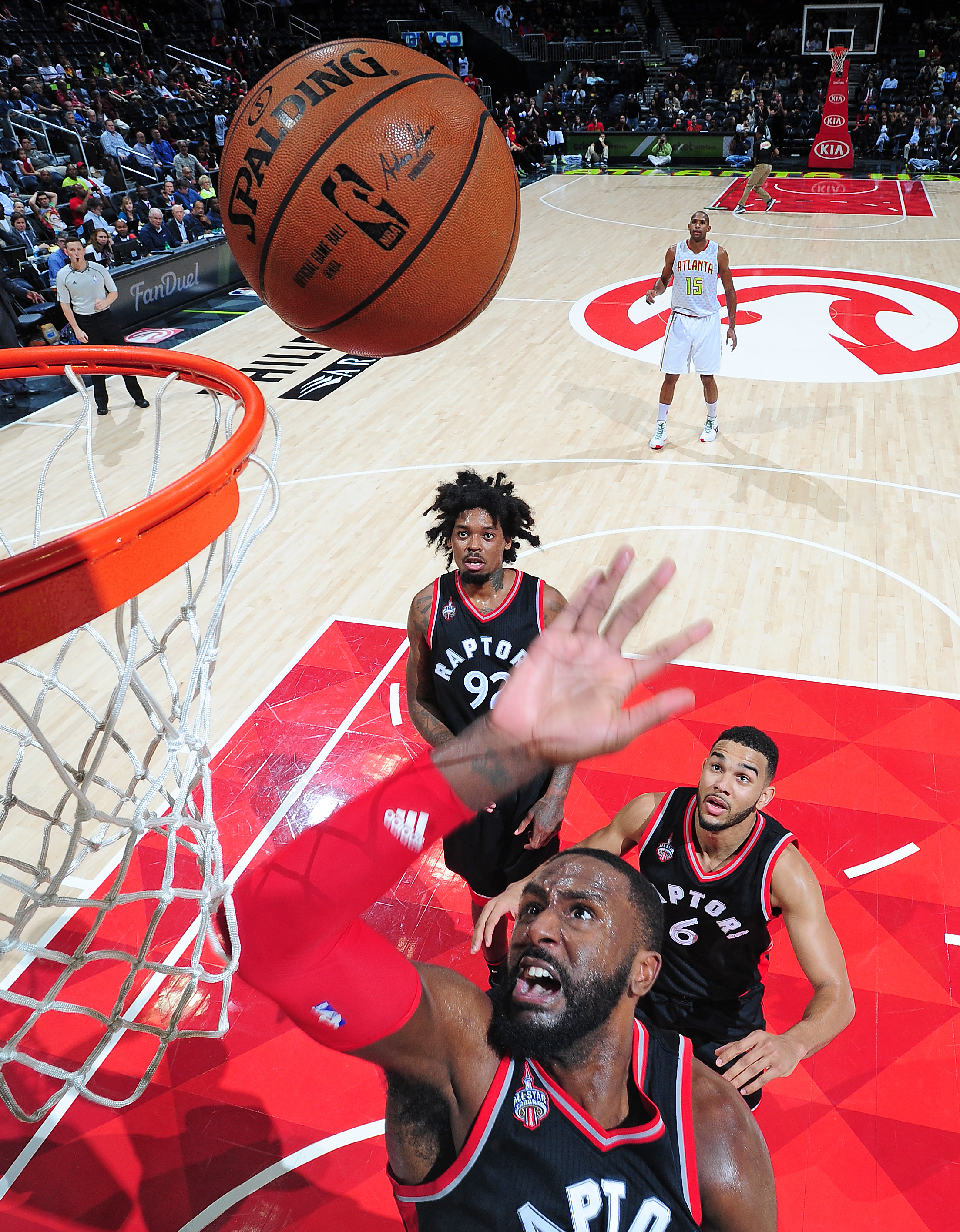 ATLANTA, GA - DECEMBER 2: Patrick Patterson #54 of the Toronto Raptors goes for the rebound during the game against the Atlanta Hawks on December 2, 2015 at Philips Arena in Atlanta, Georgia.  (Photo by Scott Cunningham/NBAE via Getty Images)