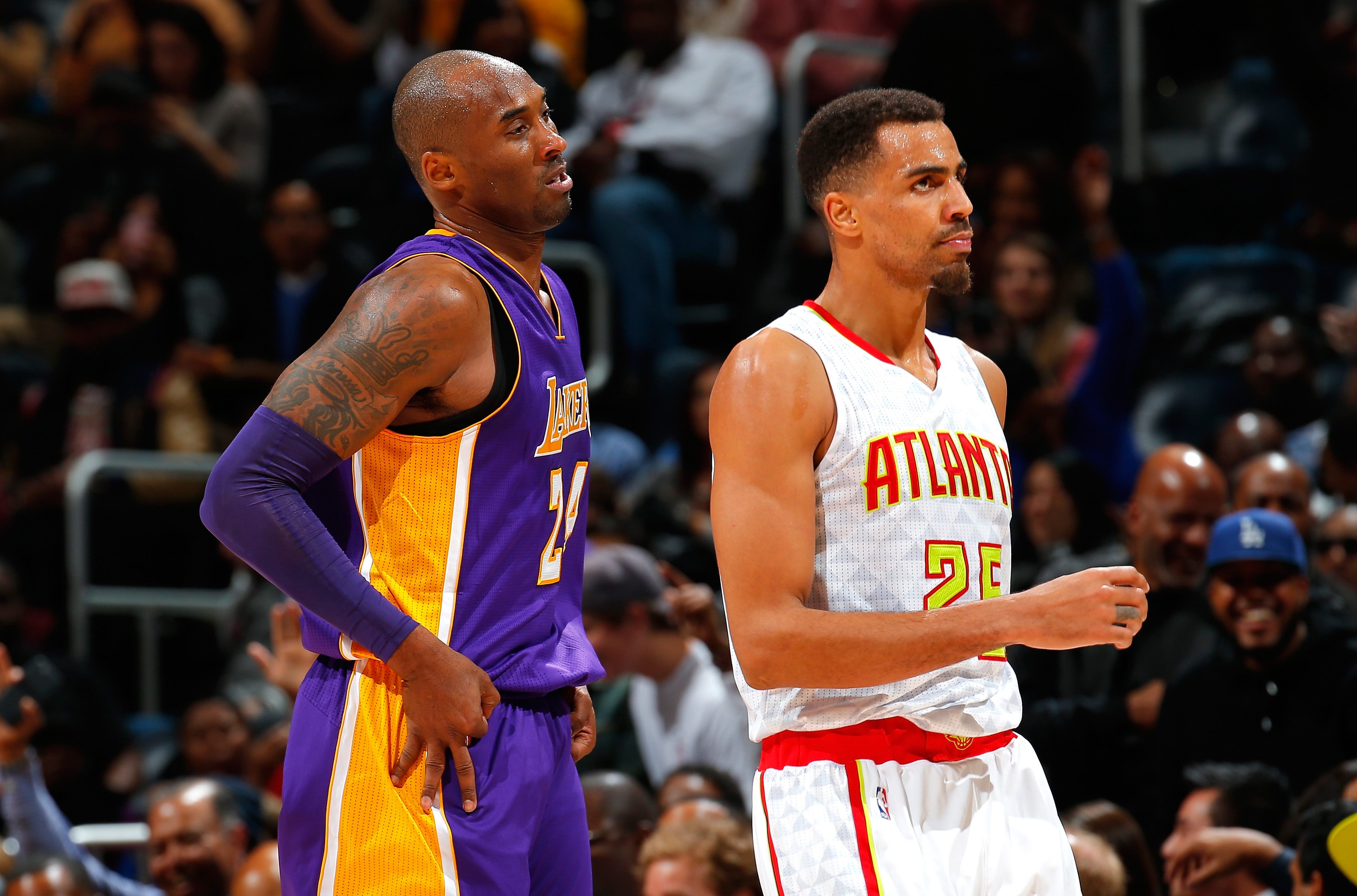 ATLANTA, GA - DECEMBER 04:  Kobe Bryant #24 of the Los Angeles Lakers reacts after hitting a three-point basket against Thabo Sefolosha #25 of the Atlanta Hawks at Philips Arena on December 4, 2015 in Atlanta, Georgia.  NOTE TO USER User expressly acknowl