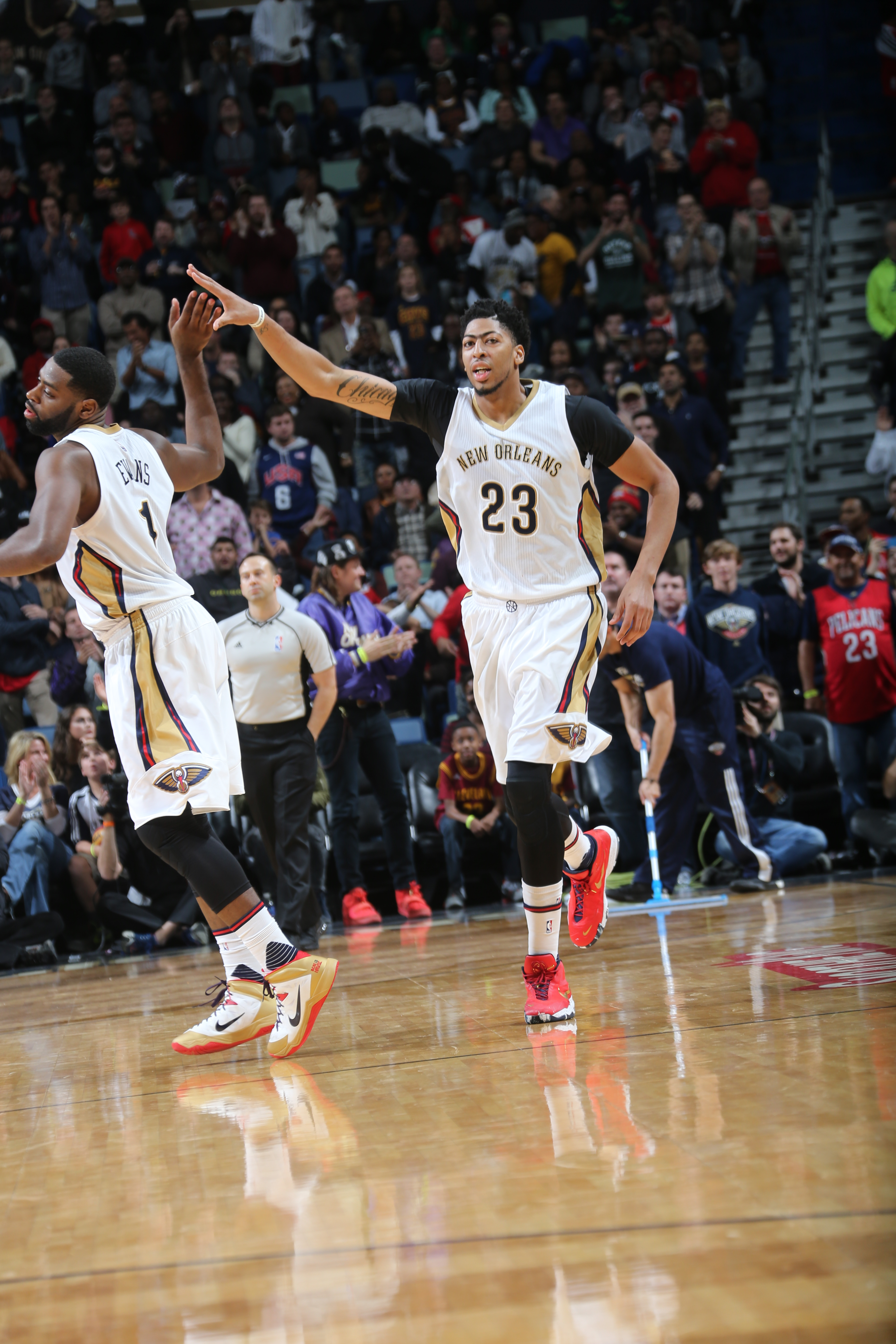 NEW ORLEANS, LA - DECEMBER 4:  Anthony Davis #23 of the New Orleans Pelicans celebrates with Tyreke Evans #1 of the New Orleans Pelicans during the game against the Cleveland Cavaliers on December 4, 2015 at Smoothie King Center in New Orleans, Louisiana.