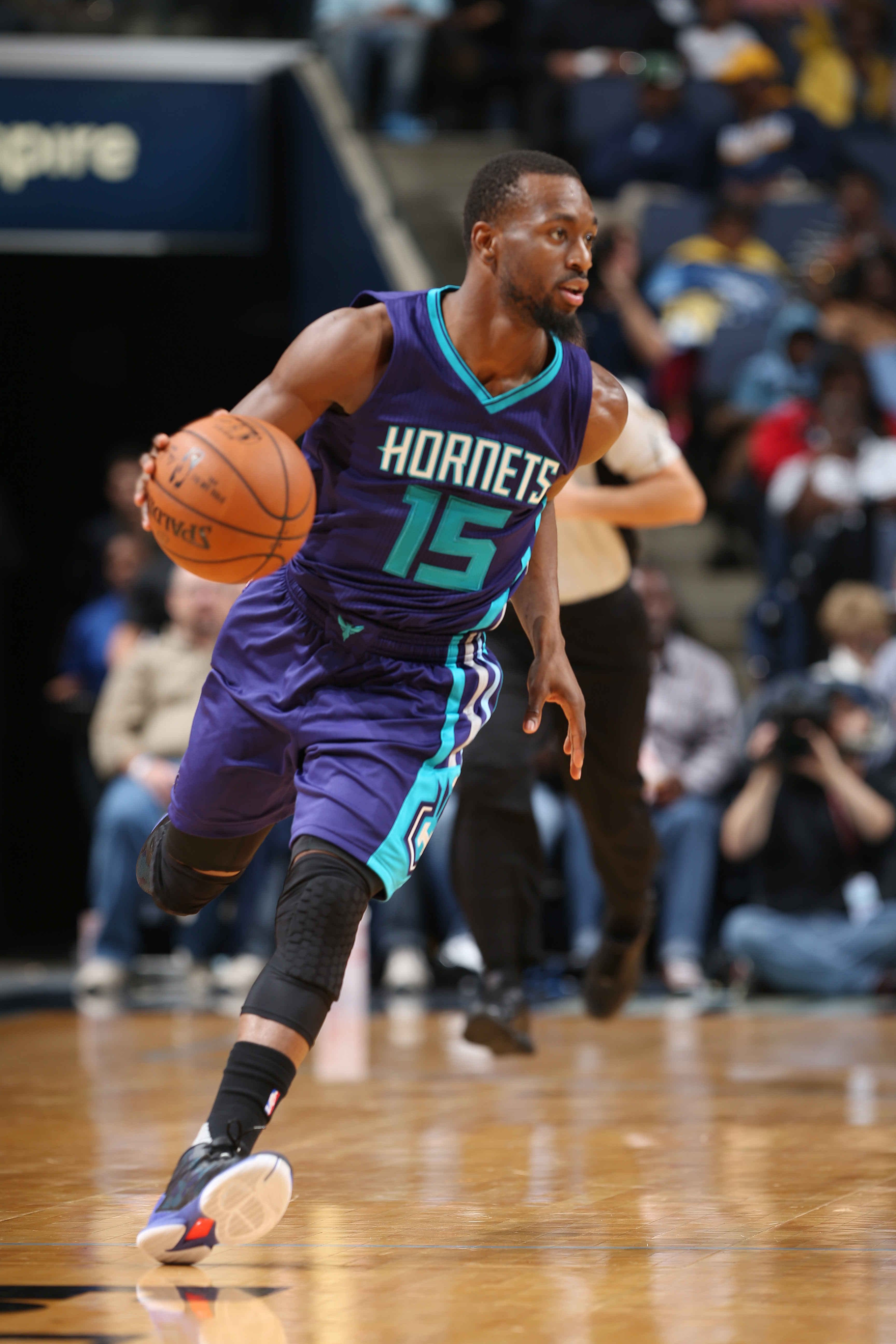 MEMPHIS, TN - DECEMBER 11: Kemba Walker #15 of the Charlotte Hornets handles the ball during the game against the Memphis Grizzlies on December 11, 2015 at FedExForum in Memphis, Tennessee. (Photo by Joe Murphy/NBAE via Getty Images)