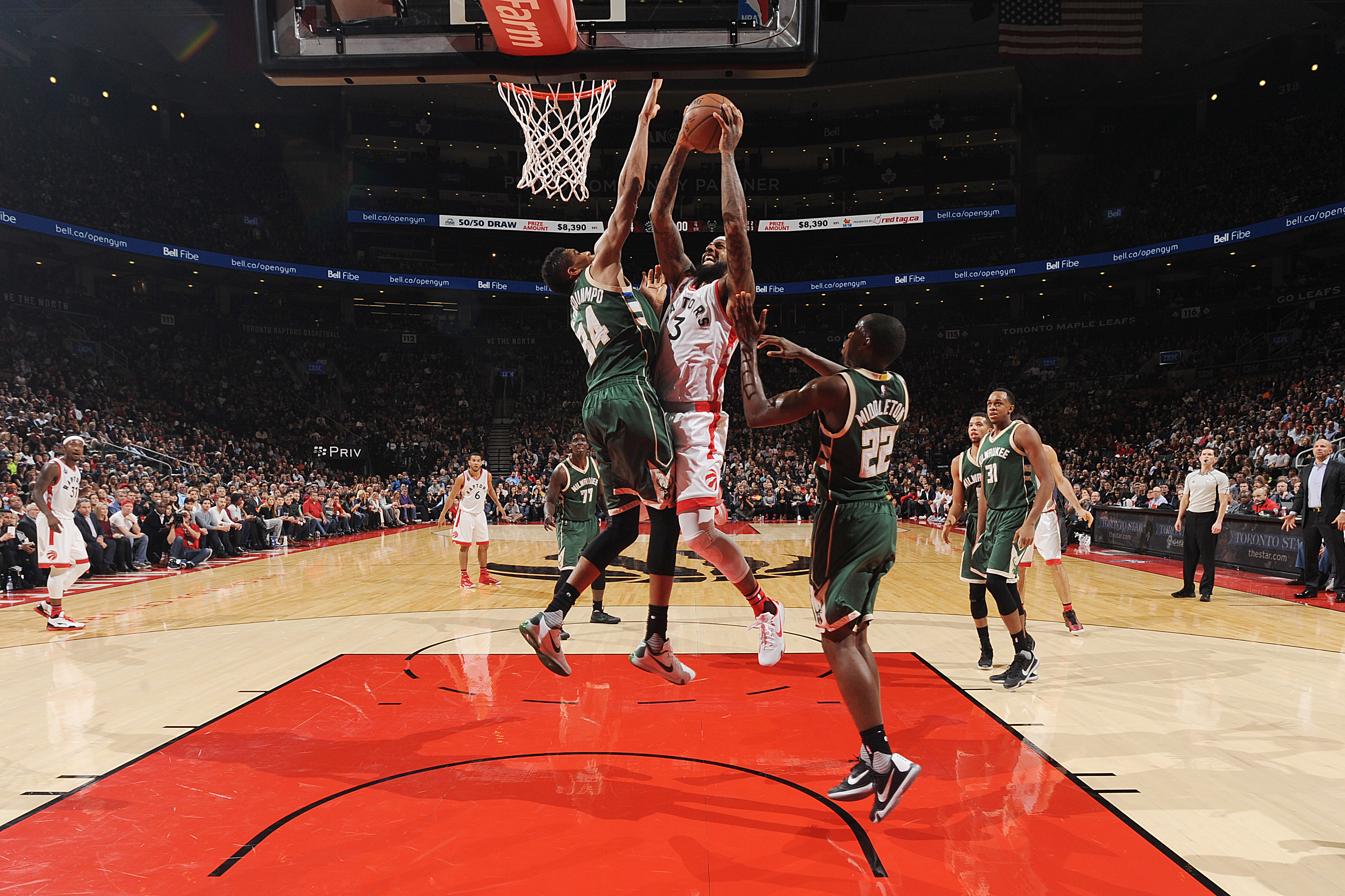 TORONTO, CANADA - DECEMBER 11:  James Johnson #3 of the Toronto Raptors shoots the ball against the Milwaukee Bucks on December 11, 2015 at the Air Canada Centre in Toronto, Ontario, Canada.  (Photo by Ron Turenne/NBAE via Getty Images)