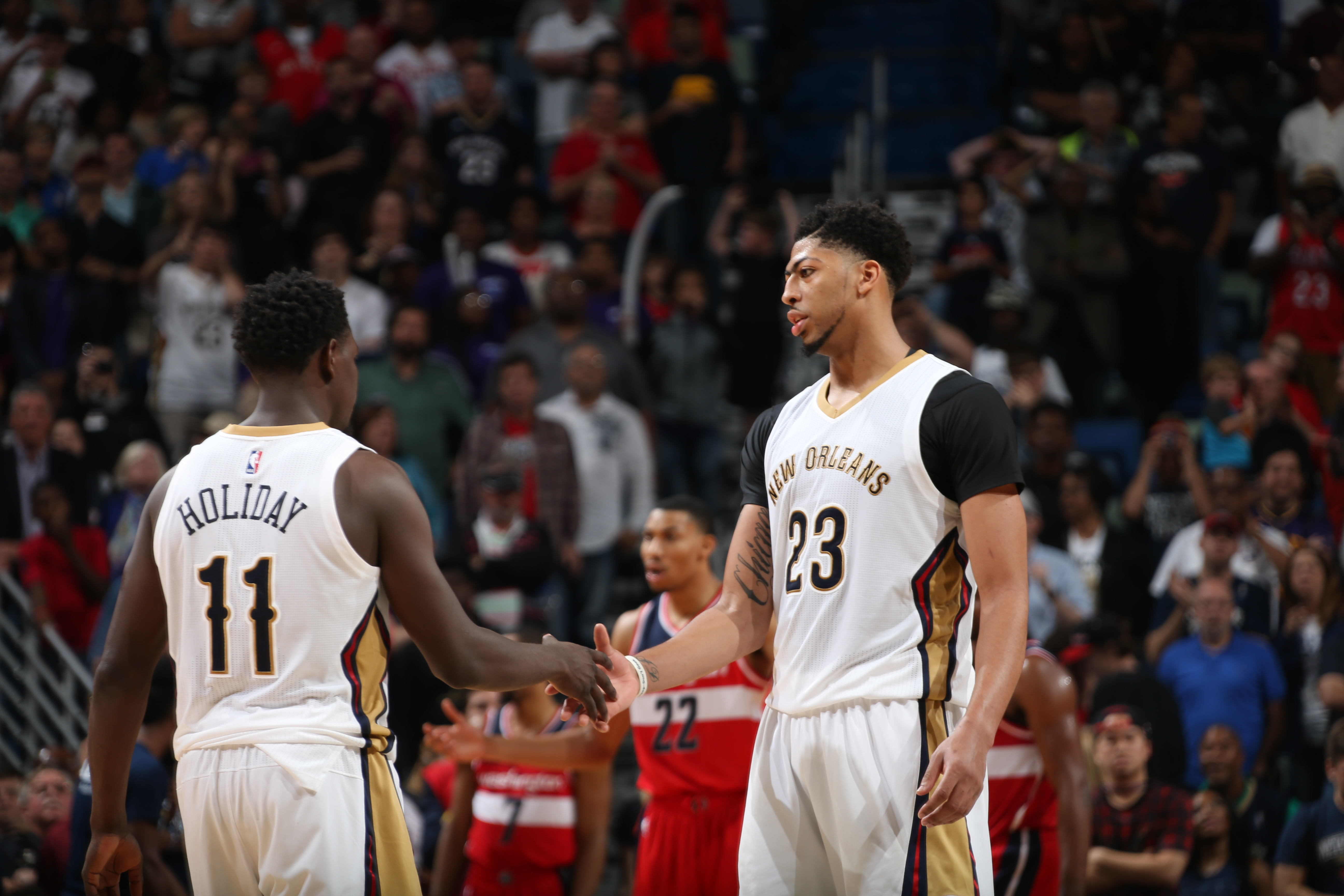 NEW ORLEANS, LA - DECEMBER 11:  Jrue Holiday #11 of the New Orleans Pelicans high fives Anthony Davis #23 of the New Orleans Pelicans during the game against the Washington Wizards on December 11, 2015 at the Smoothie King Center in New Orleans, Louisiana