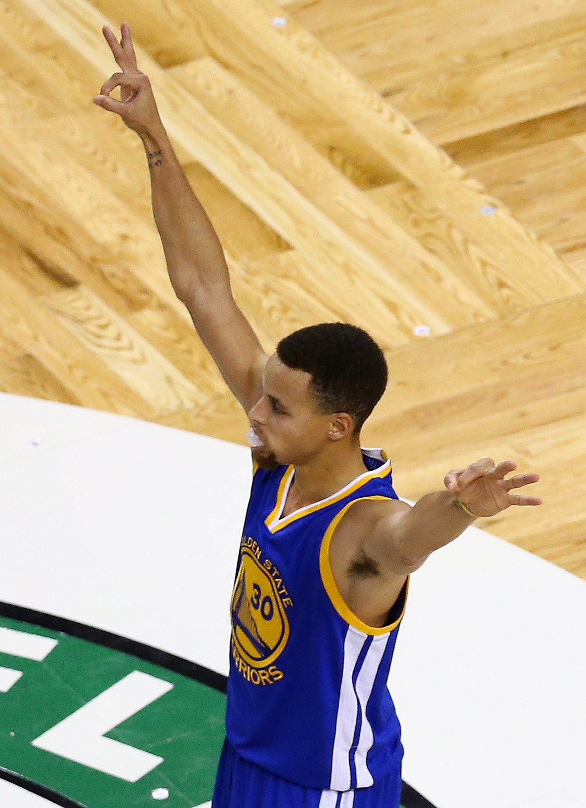 BOSTON, MA - DECEMBER 11:  Stephen Curry #30 of the Golden State Warriors reacts during overtime against the Boston Celtics at TD Garden on December 11, 2015 in Boston, Massachusetts. The Warriors defeat the Celtics 124-119. (Photo by Maddie Meyer/Getty I