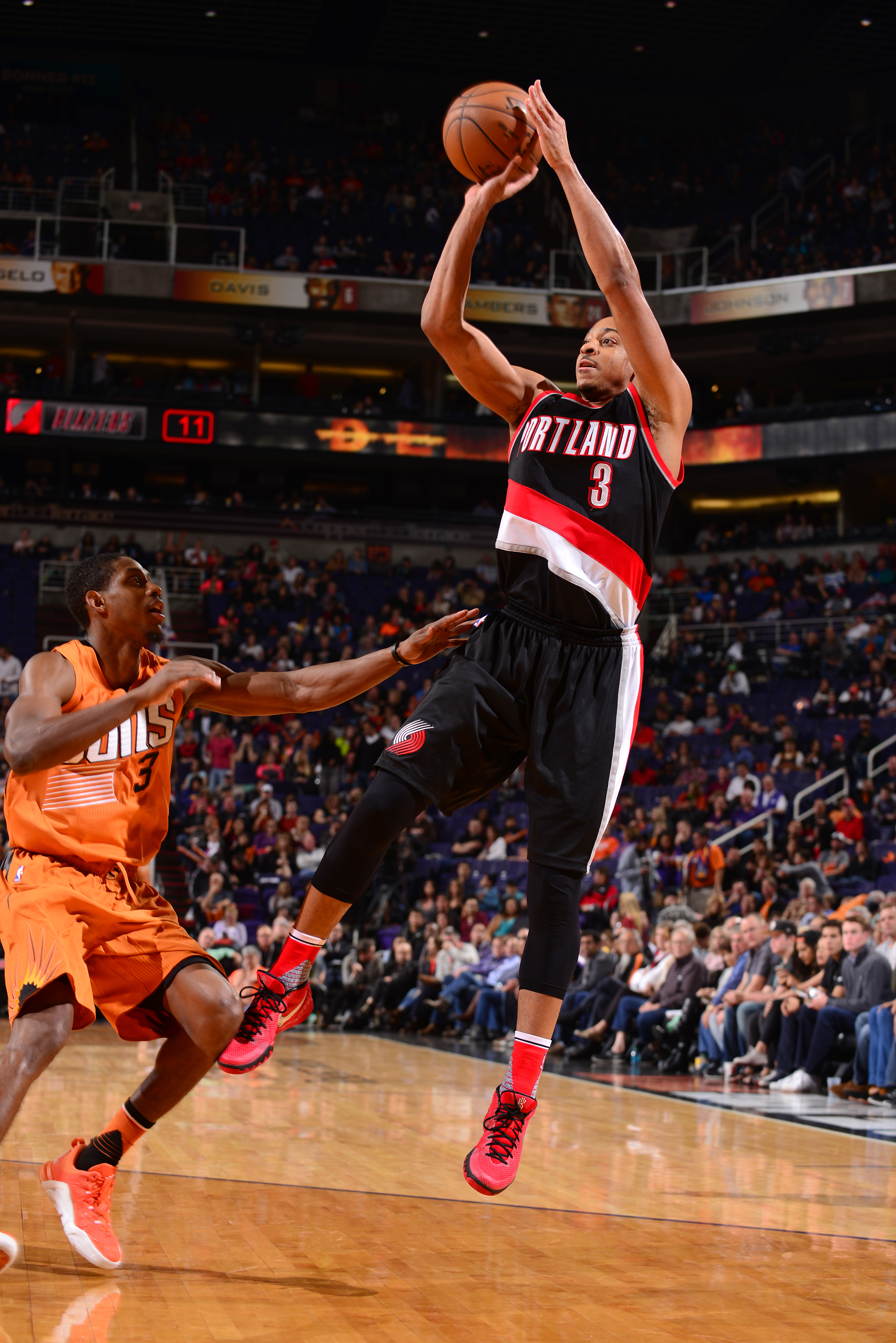 PHOENIX, AZ - DECEMBER 11: C.J. McCollum #3 of the Portland Trail Blazers shoots the ball during the game against the Phoenix Suns on December 11, 2015 at U.S. Airways Center in Phoenix, Arizona. (Photo by Barry Gossage/NBAE via Getty Images)