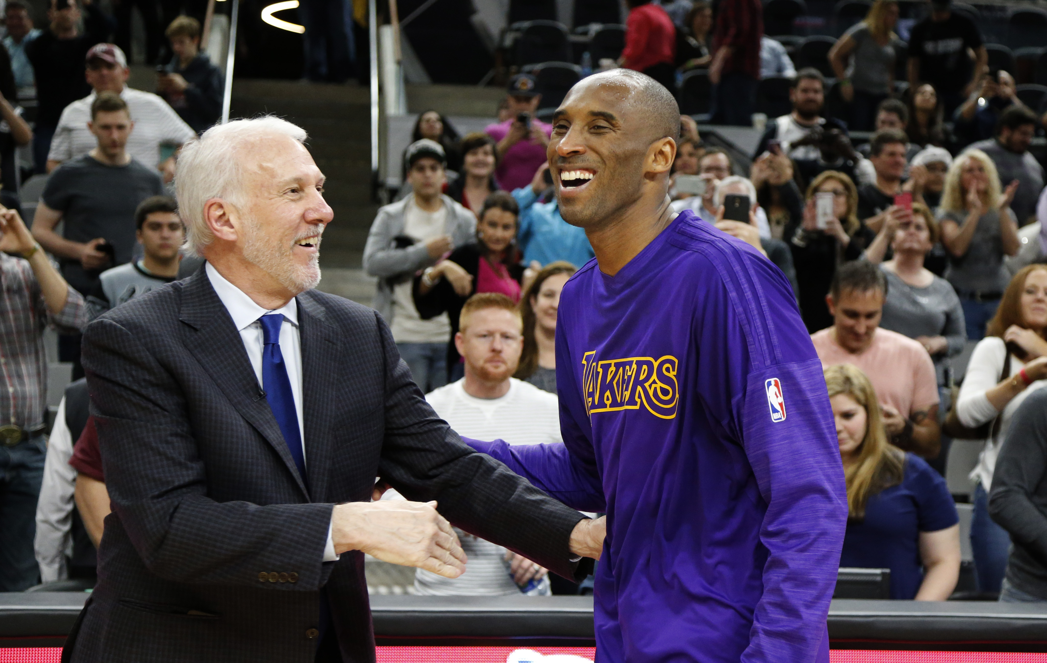 SAN ANTONIO, TX - DECEMBER 11: Kobe Bryant #24 of the Los Angeles Lakers talks with head coach Gregg Popovich of the San Antonio Spurs at the end of the game at AT&T Center on December 11, 2015 in San Antonio,Texas.  (Photo by Ron Cortes/Getty Images)