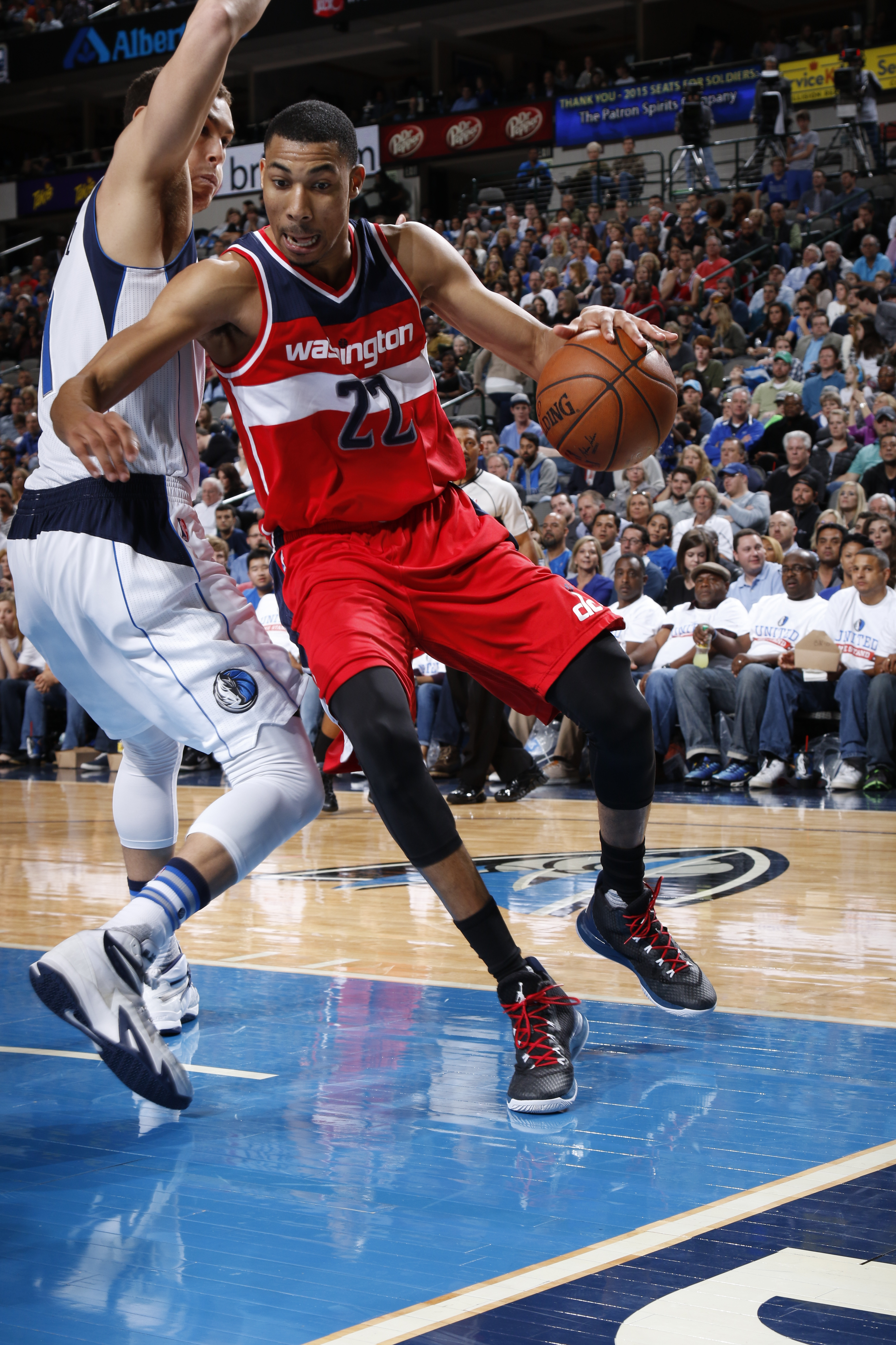 DALLAS, TX - DECEMBER 12: Otto Porter Jr. #22 of the Washington Wizards drives against the Dallas Mavericks on December 12, 2015 at the American Airlines Center in Dallas, Texas. (Photo by Glenn James/NBAE via Getty Images)