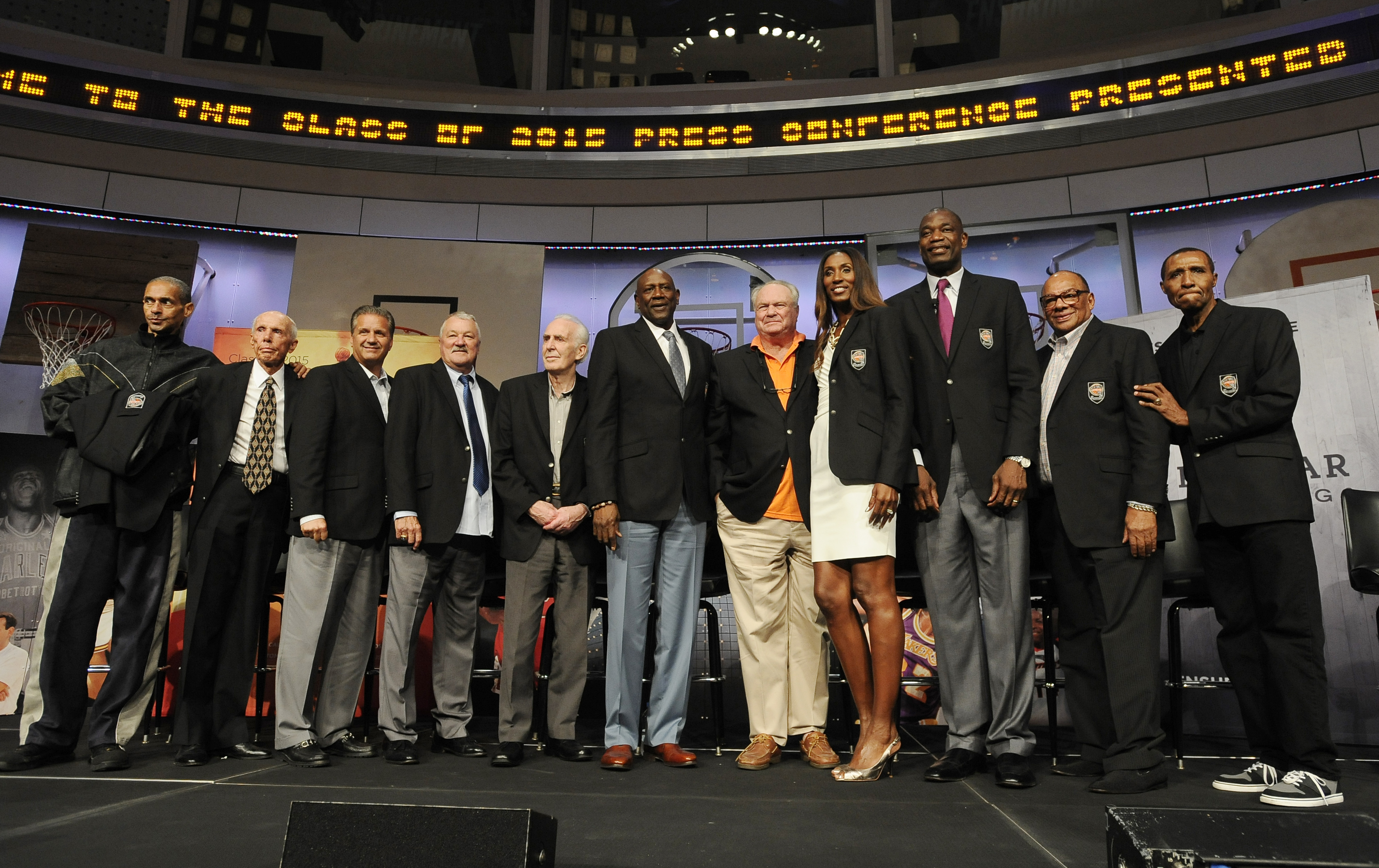 The 2015 class of inductees into the Basketball Hall of Fame, from the left, Alex Isaacs, accepting on behalf of his father John Isaacs, Dick Bavetta, John Calipari, Louis Dampier, Lindsay Gaze, Spencer Haywood, Tom Heinsohn, Lisa Leslie, Dikembe Mutombo,