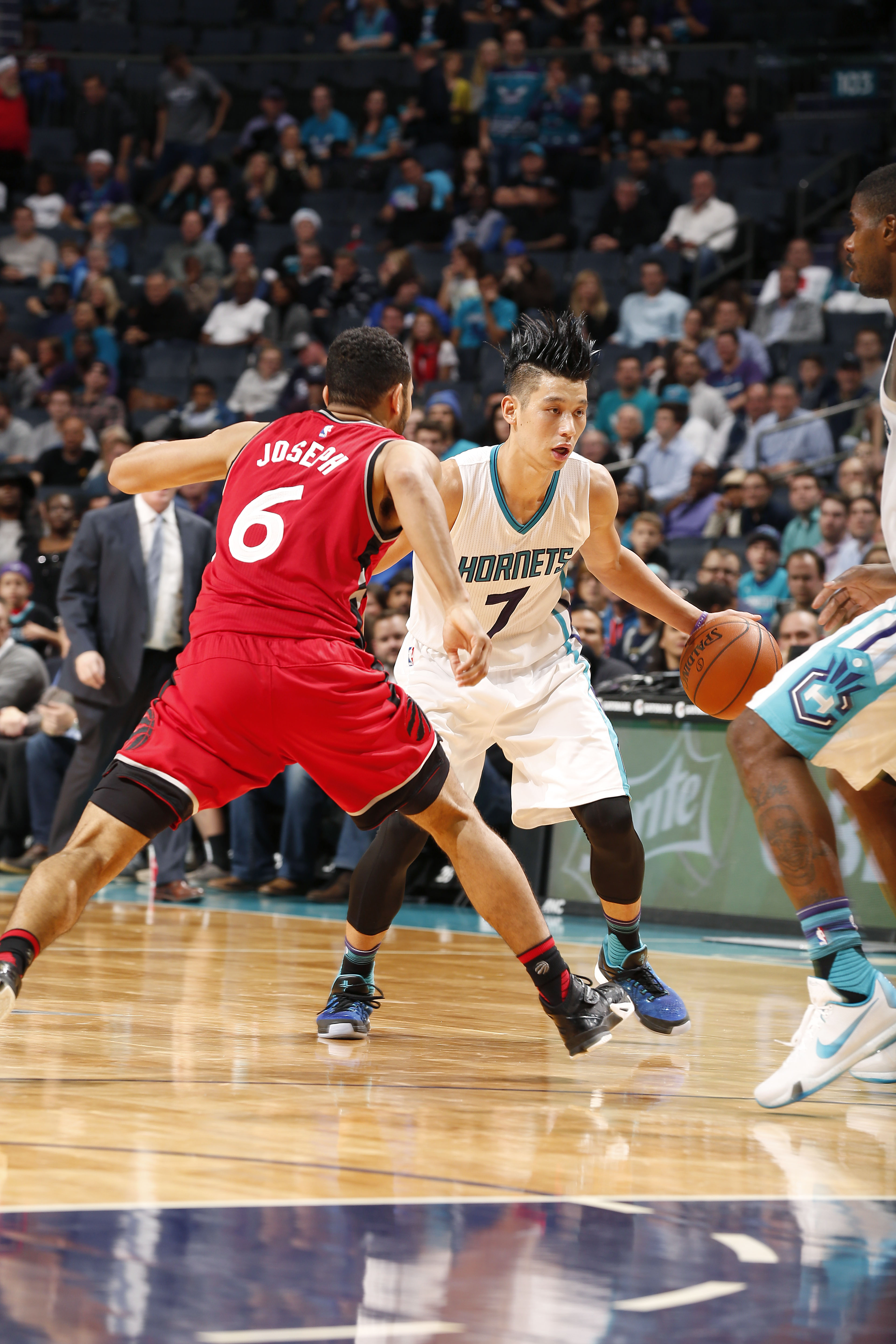 CHARLOTTE, NC - DECEMBER 17: Jeremy Lin #7 of the Charlotte Hornets handles the ball during the game against the Toronto Raptors on December 17, 2015 at Time Warner Cable Arena in Charlotte, North Carolina. (Photo by Brock Williams-Smith/NBAE via Getty Im