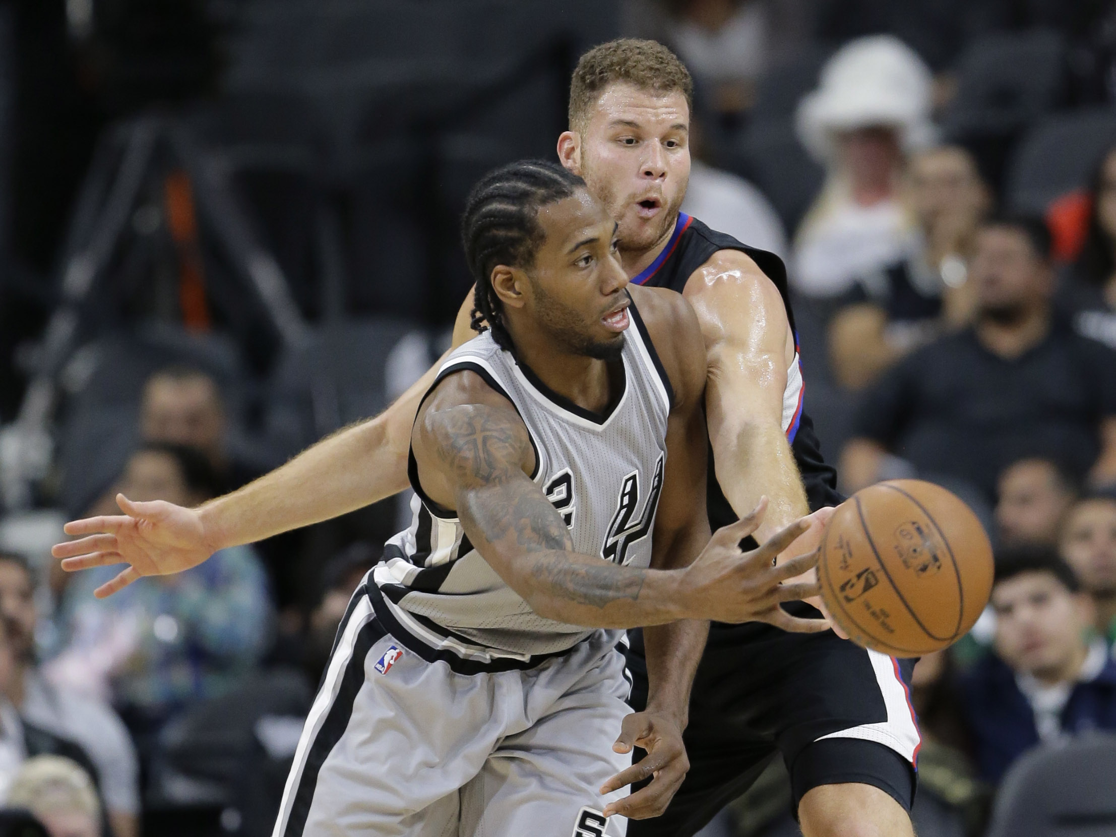 San Antonio Spurs forward Kawhi Leonard (2) is pressured by Los Angeles Clippers forward Blake Griffin during the first half of an NBA basketball game, Friday, Dec. 18, 2015, in San Antonio. (AP Photo/Eric Gay)