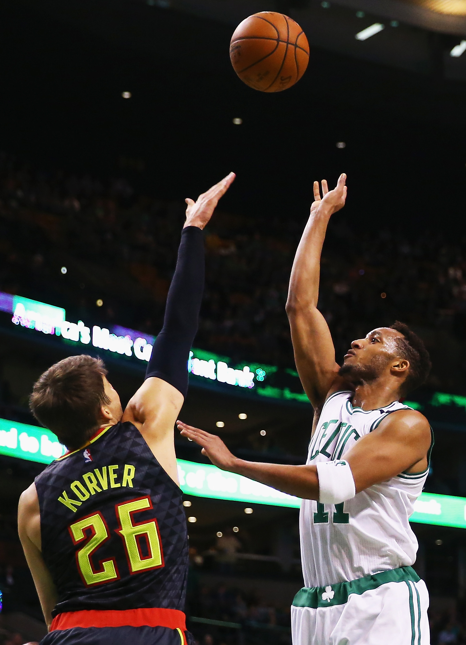 BOSTON, MA - DECEMBER 18:  Evan Turner #11 of the Boston Celtics takes a shot over Kyle Korver #26 of the Atlanta Hawks  during the second quarter at TD Garden on December 18, 2015 in Boston, Massachusetts.(Photo by Maddie Meyer/Getty Images)