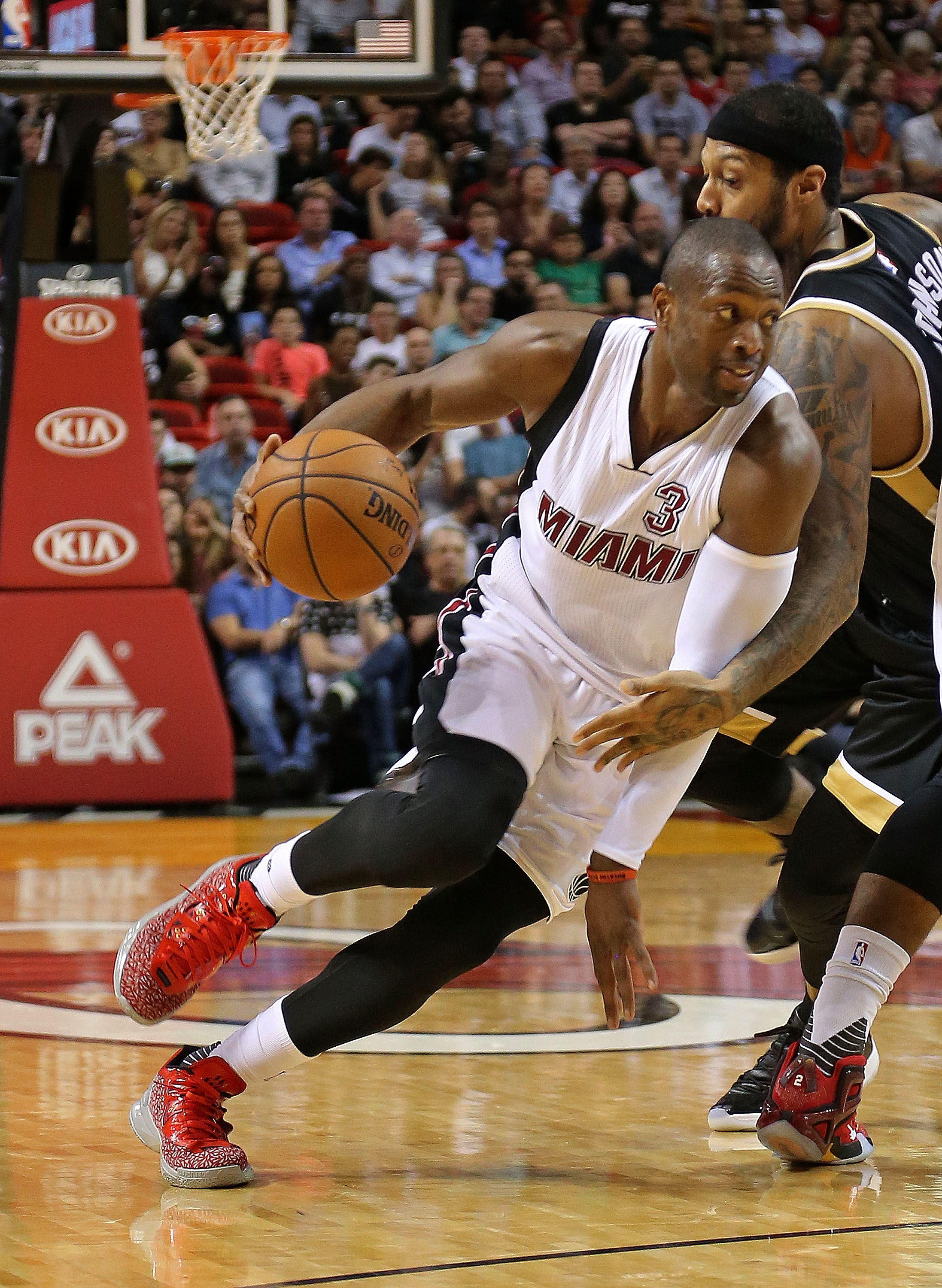 MIAMI, FL - DECEMBER 18:  Dwyane Wade #3 of the Miami Heat drives to the basket during a game against the Toronto Raptors at American Airlines Arena on December 18, 2015 in Miami, Florida. (Photo by Mike Ehrmann/Getty Images)