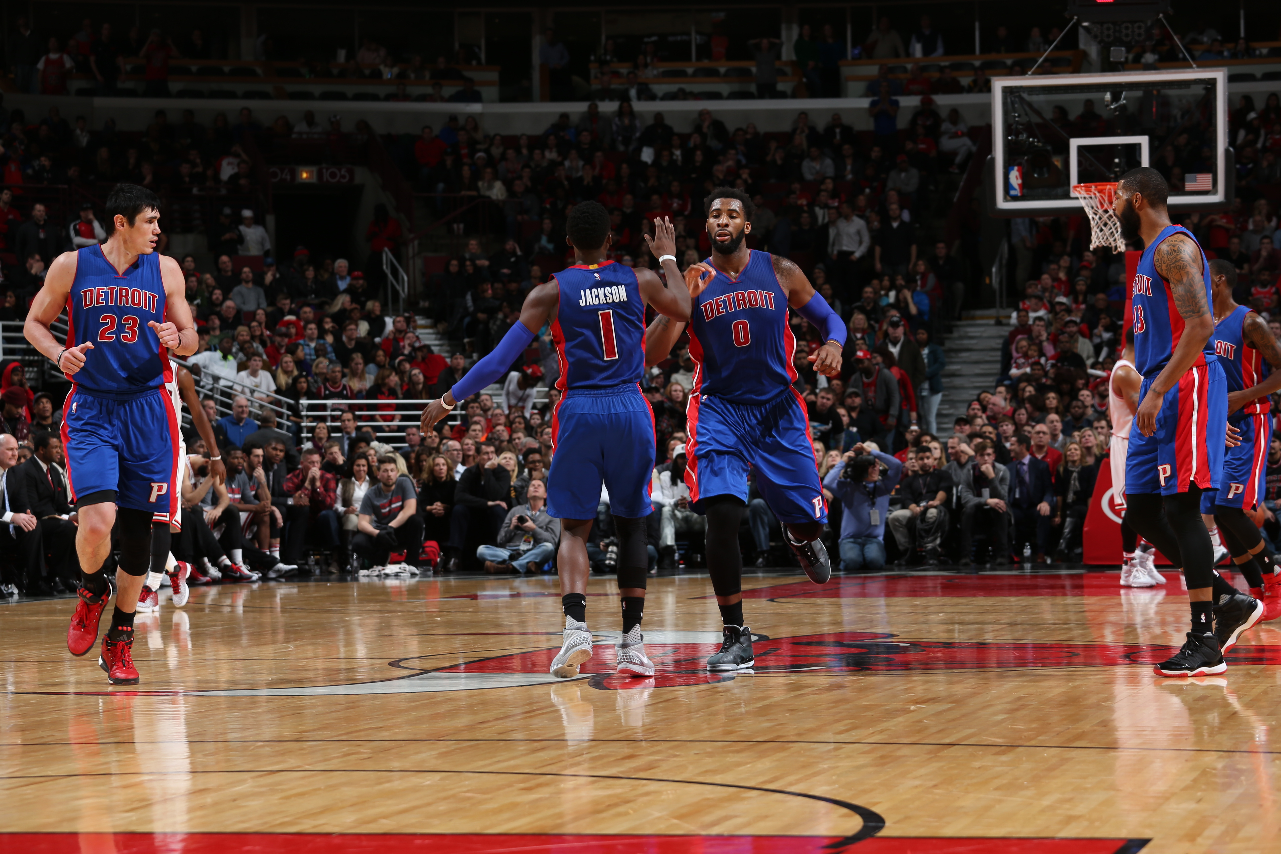 CHICAGO, IL - DECEMBER 18:  Reggie Jackson #1 of the Detroit Pistons high fives Andre Drummond #0 of the Detroit Pistons during the game against the Chicago Bulls on December 18, 2015 at the United Center in Chicago, Illinois. (Photo by Gary Dineen/NBAE v