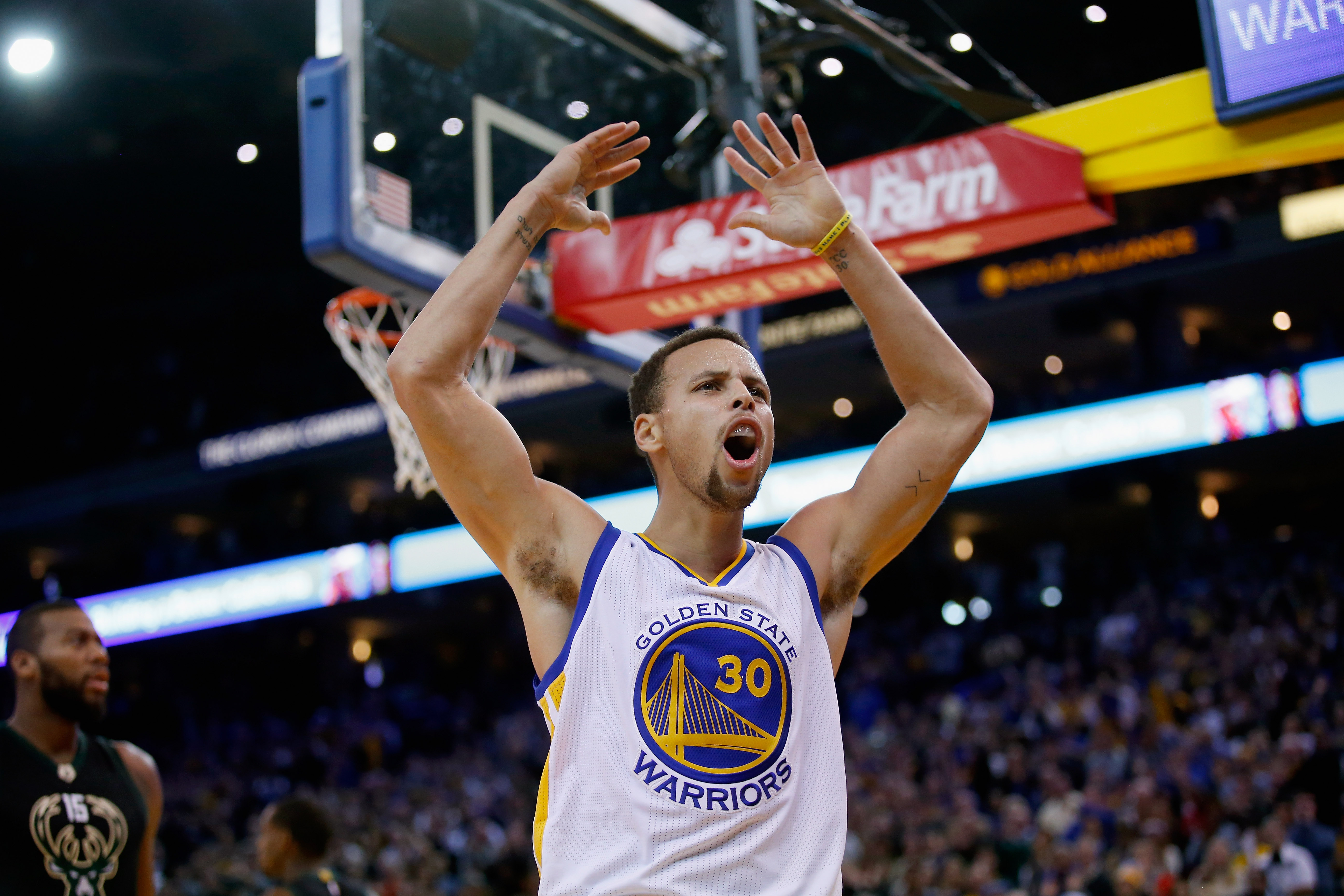OAKLAND, CA - DECEMBER 18:  Stephen Curry #30 of the Golden State Warriors reacts towards the crowd during their game against the Milwaukee Bucks at ORACLE Arena on December 18, 2015 in Oakland, California. (Photo by Ezra Shaw/Getty Images)