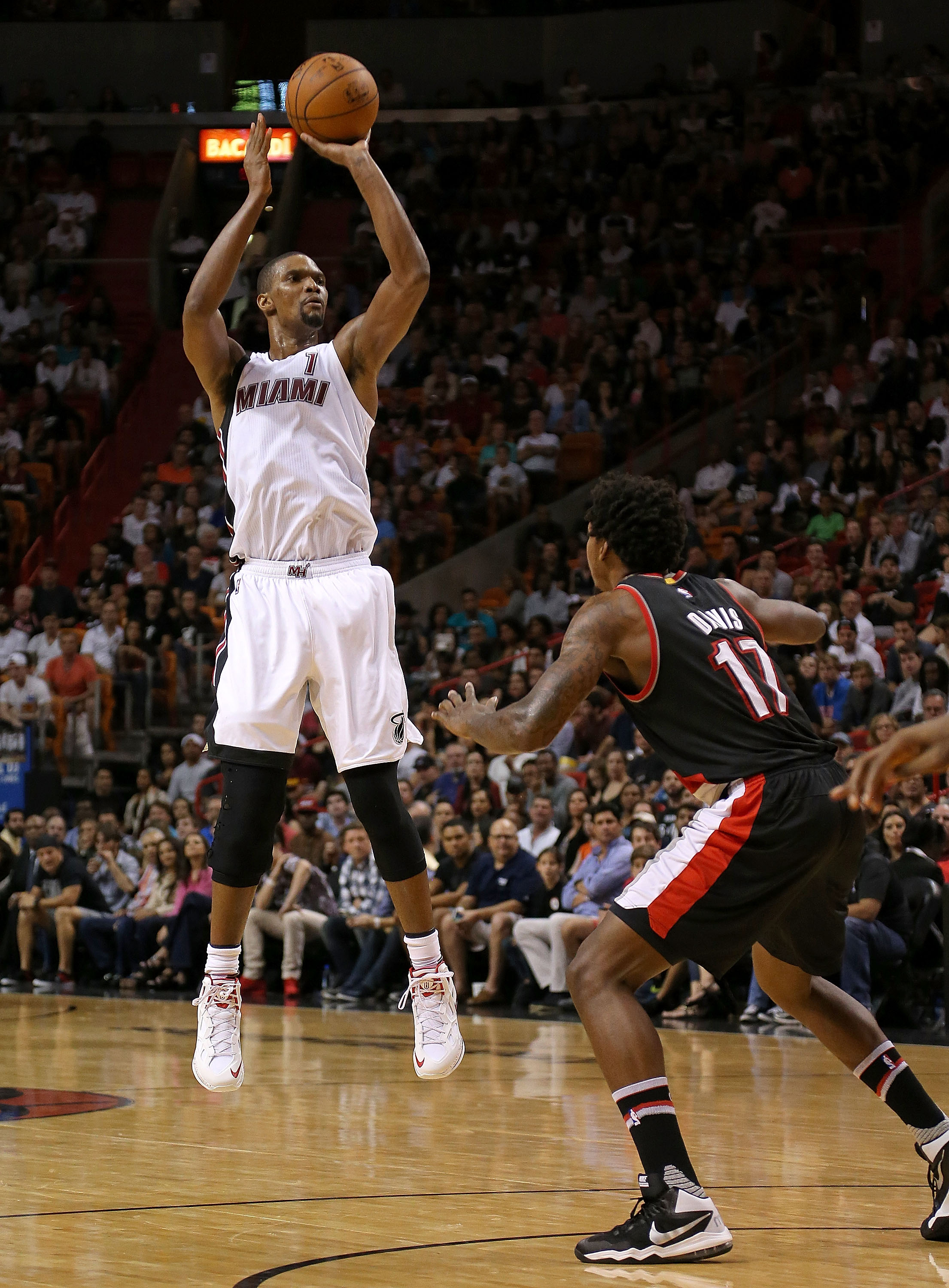 MIAMI, FL - DECEMBER 20:  Chris Bosh #1 of the Miami Heat is guarded by Ed Davis #17 of the Portland Trail Blazers during a game  at American Airlines Arena on December 20, 2015 in Miami, Florida. (Photo by Mike Ehrmann/Getty Images)