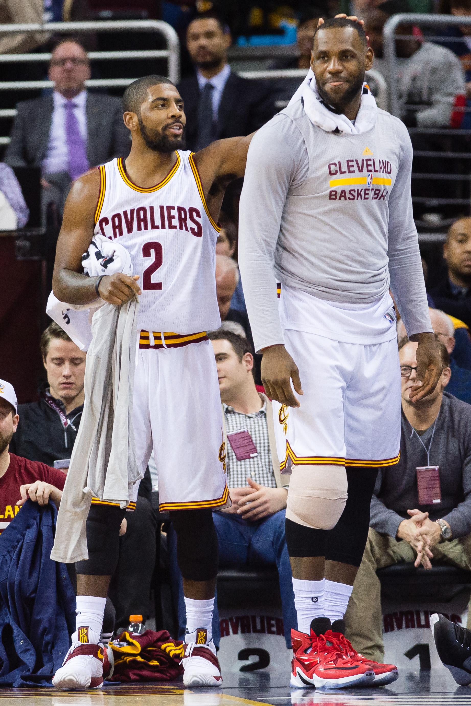 CLEVELAND, OH - DECEMBER 20: Kyrie Irving #2 and LeBron James #23 of the Cleveland Cavaliers celebrate on the sidelines during the second half against the Philadelphia 76ers at Quicken Loans Arena on December 20, 2015 in Cleveland, Ohio. The Cavaliers def