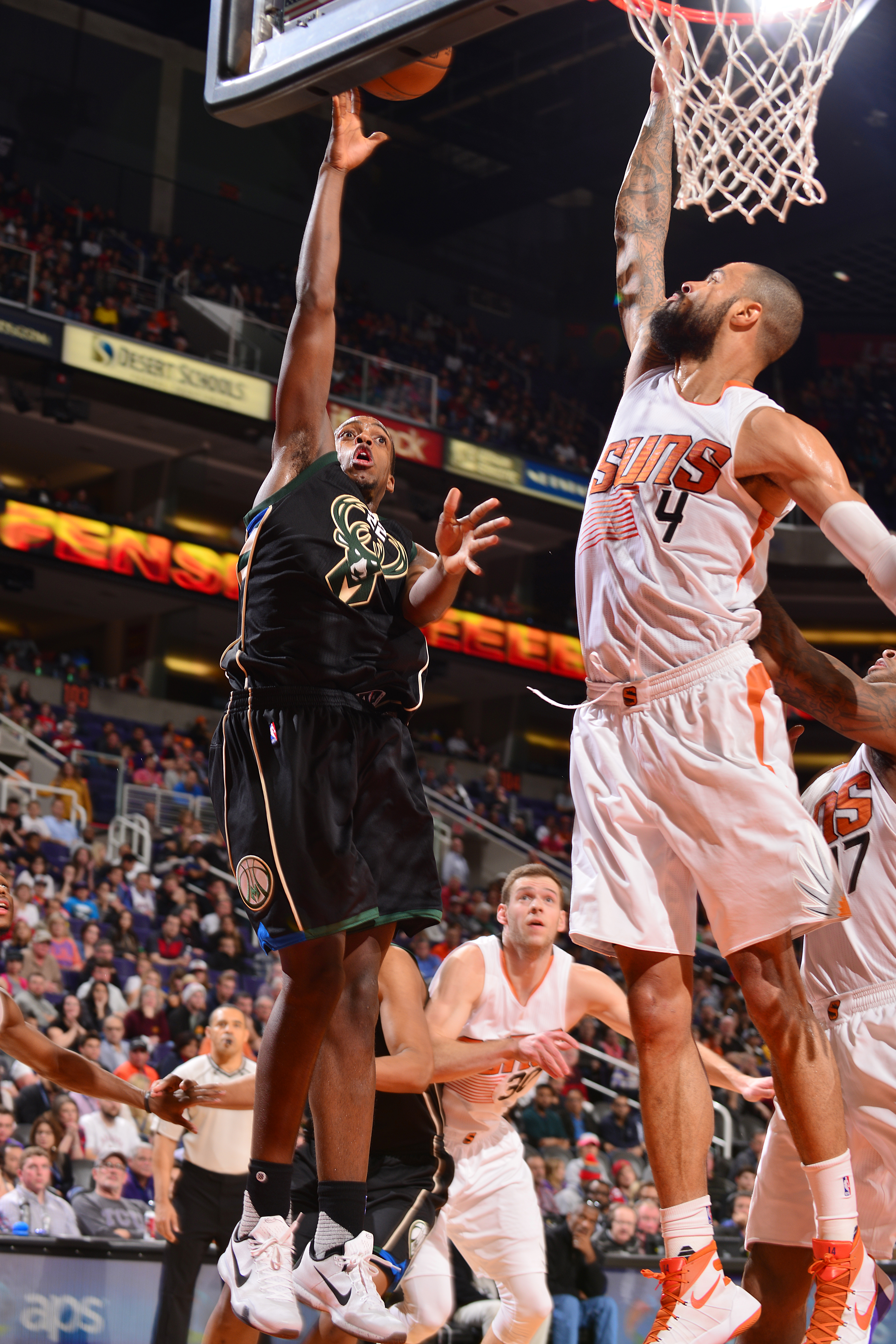 PHOENIX, AZ - DECEMBER 20: Khris Middleton #22 of the Milwaukee Bucks shoots the ball during the game against the Phoenix Suns on December 20, 2015 at U.S. Airways Center in Phoenix, Arizona. (Photo by Barry Gossage/NBAE via Getty Images)