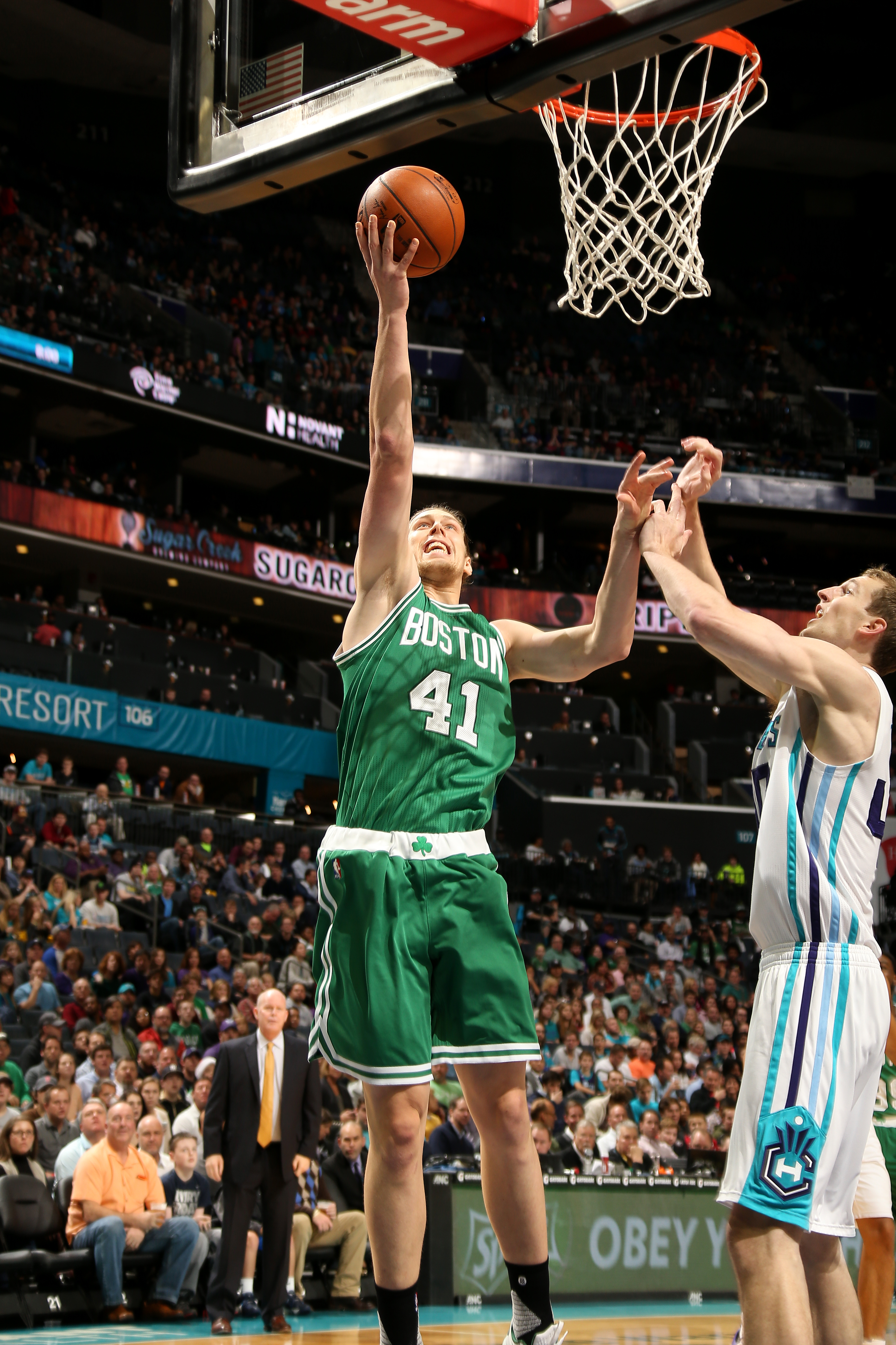CHARLOTTE, NC - DECEMBER 23: Kelly Olynyk #41 of the Boston Celtics shoots a lay up during the game against the Charlotte Hornets on December 23, 2015 at Time Warner Cable Arena in Charlotte, North Carolina. (Photo by Kent Smith/NBAE via Getty Images)
