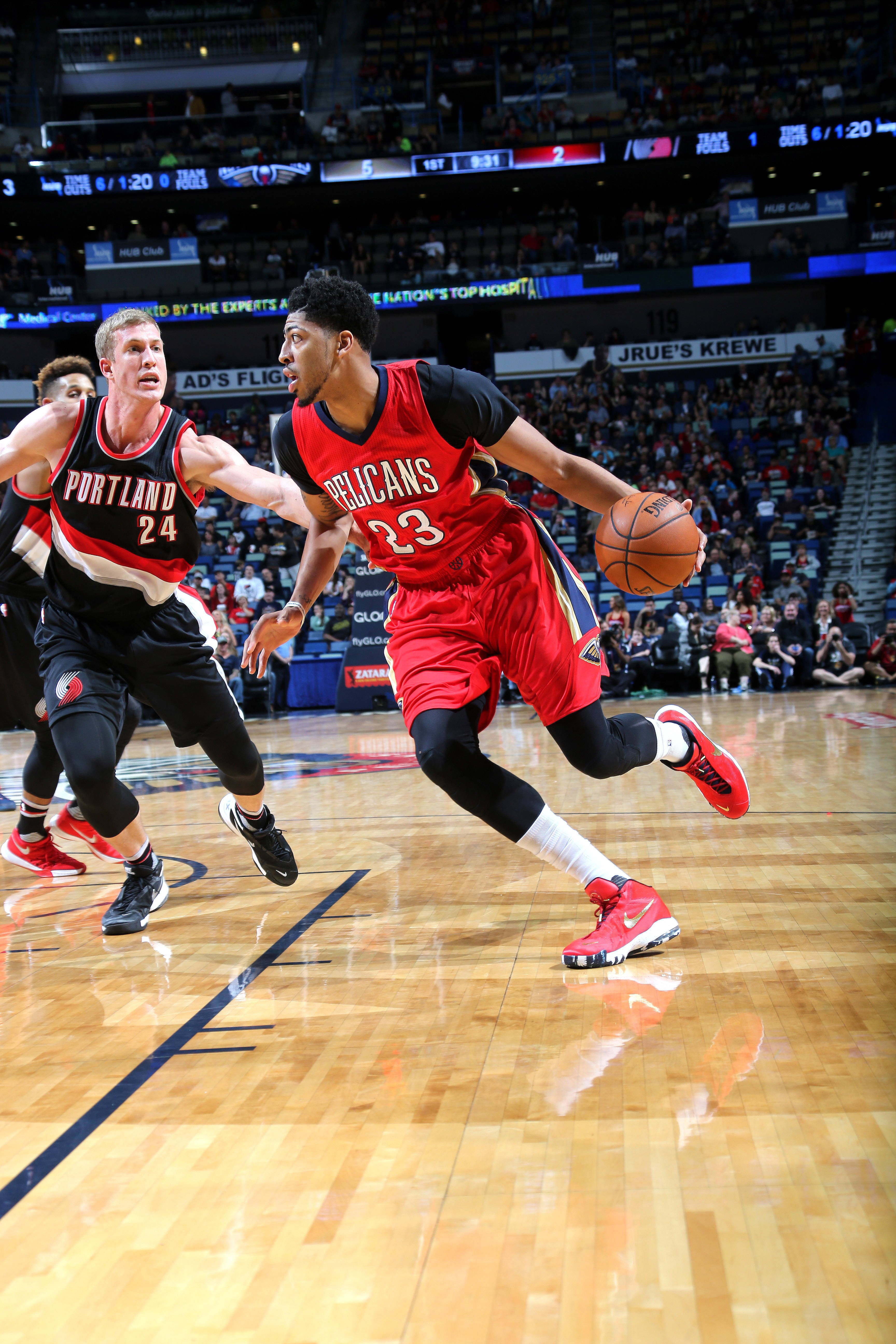 NEW ORLEANS, LA - DECEMBER 23: Anthony Davis #23 of the New Orleans Pelicans handles the ball during the game against the Portland Trail Blazers on December 23, 2015 at the Smoothie King Center in New Orleans, Louisiana. (Photo by Layne Murdoch/NBAE via G