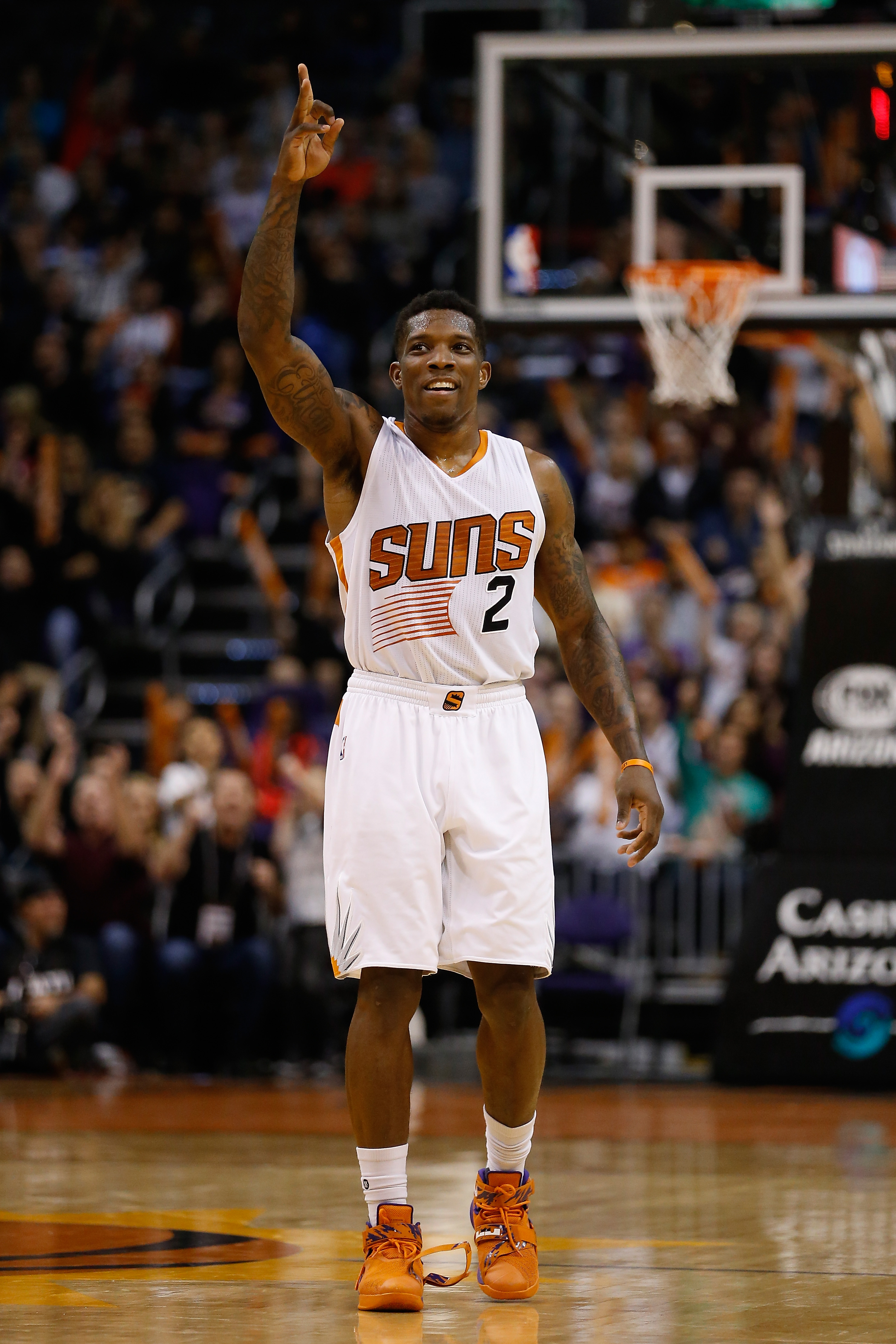 PHOENIX, AZ - DECEMBER 23:  Eric Bledsoe #2 of the Phoenix Suns reacts after Ronnie Price (not pictured) hit a three point shot against the Denver Nuggets during the second half of the NBA game at Talking Stick Resort Arena on December 23, 2015 in Phoenix