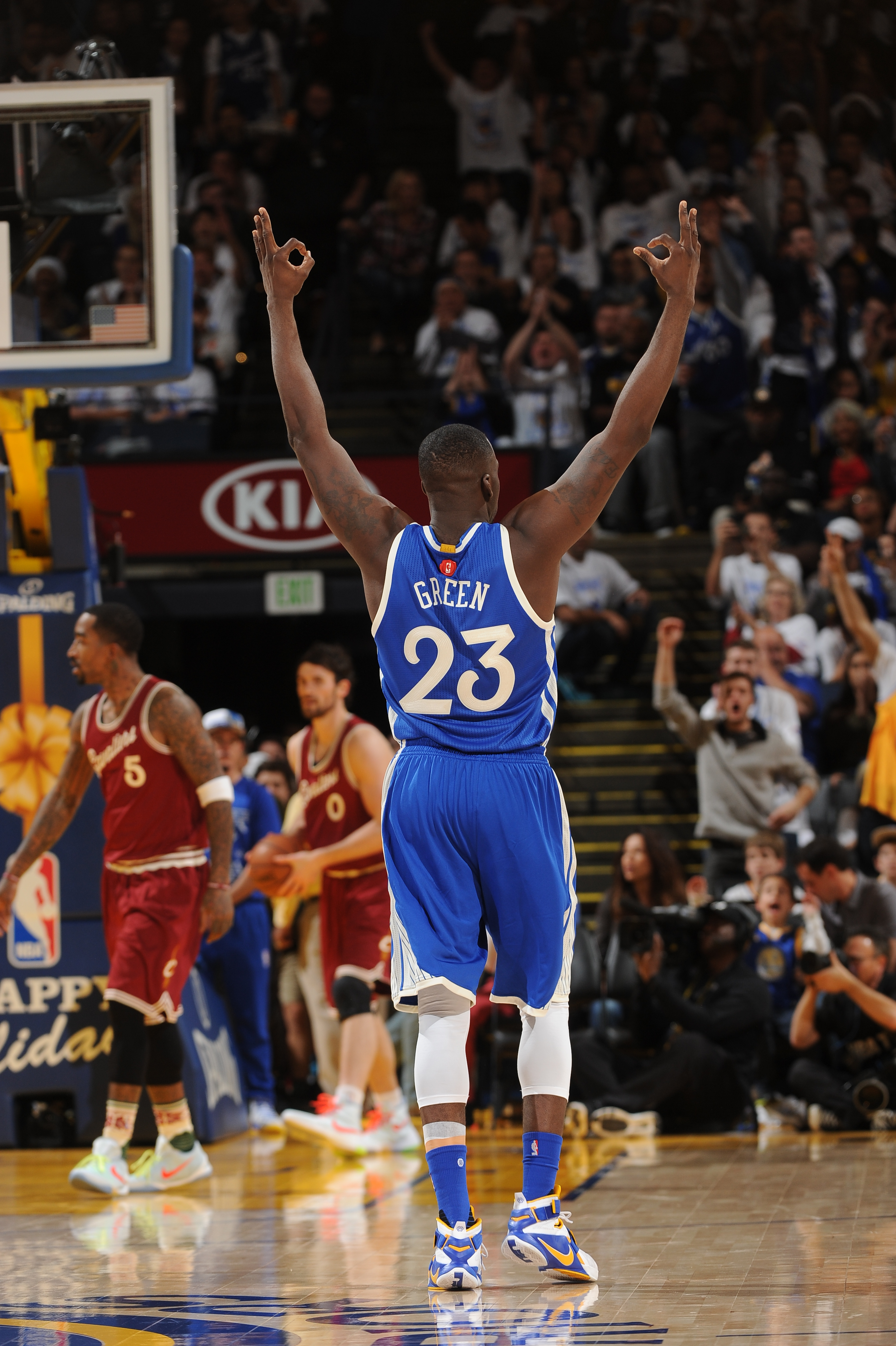 OAKLAND, CA - DECEMBER 25:  Draymond Green #23 of the Golden State Warriors responds after hitting a three pointer against the Cleveland Cavaliers on December 25, 2015 at ORACLE Arena in Oakland,California.(Photo by Noah Graham/NBAE via Getty Images)