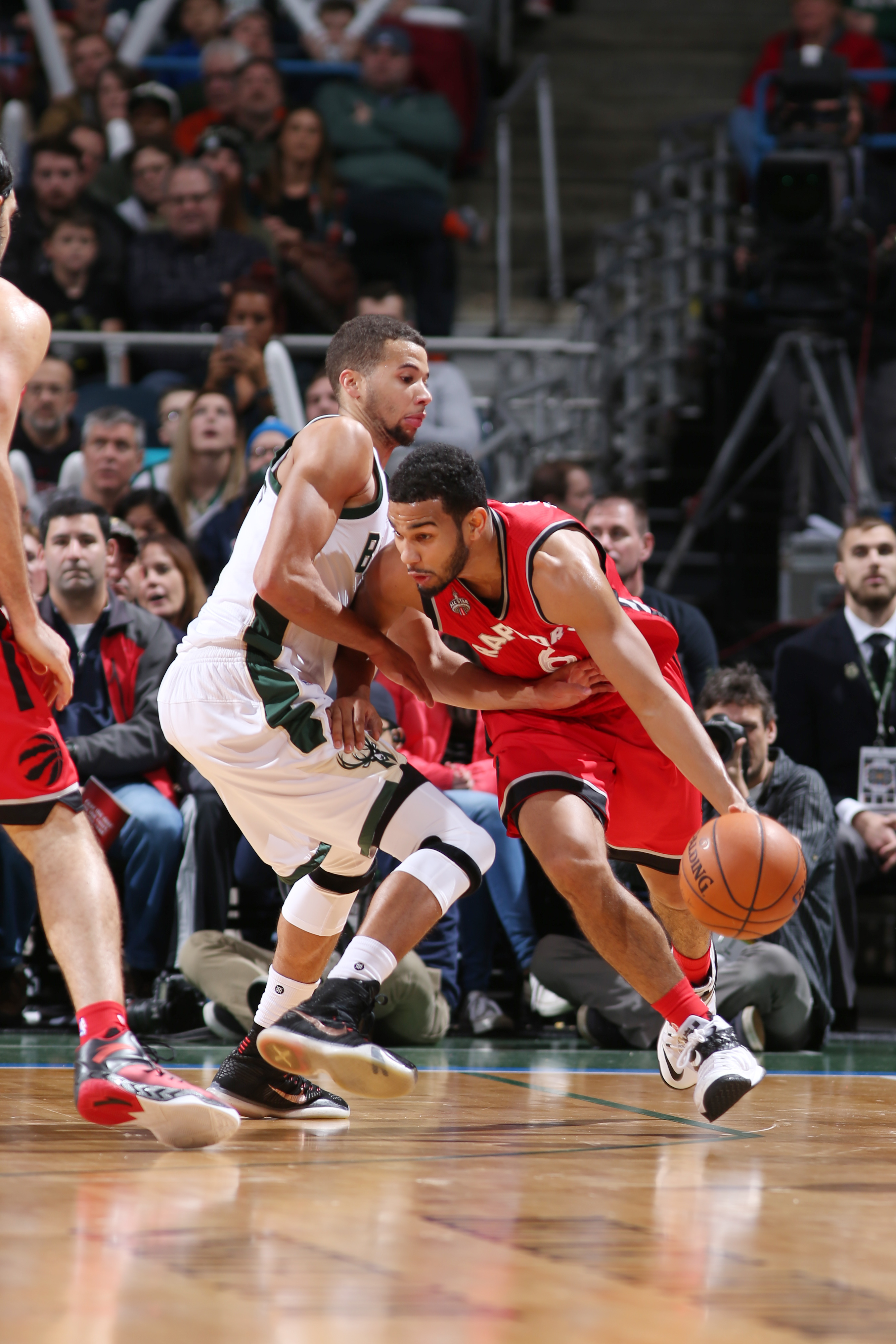 MILWAUKEE, WI - DECEMBER 26: Cory Joseph #6 of the Toronto Raptors drives to the basket against the Milwaukee Bucks during the game on December 26, 2015 at BMO Harris Bradley Center in Milwaukee, Wisconsin. (Photo by Gary Dineen/NBAE via Getty Images)