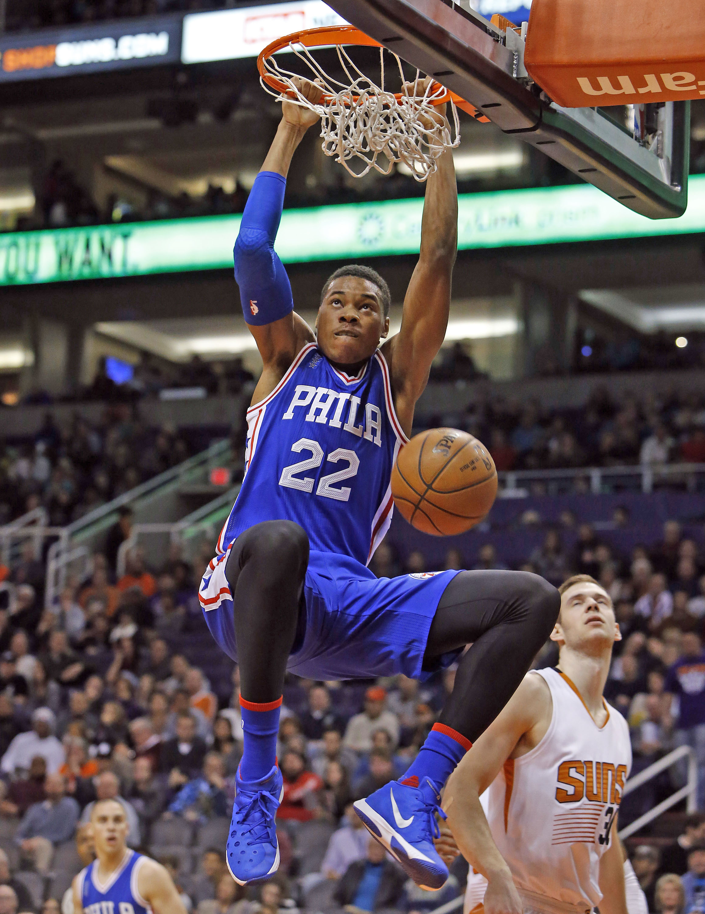 Philadelphia 76ers forward Richaun Holmes (22) dunks against the Phoenix Suns in the second quarter during an NBA basketball game, Saturday, Dec. 26, 2015, in Phoenix. (AP Photo/Rick Scuteri)