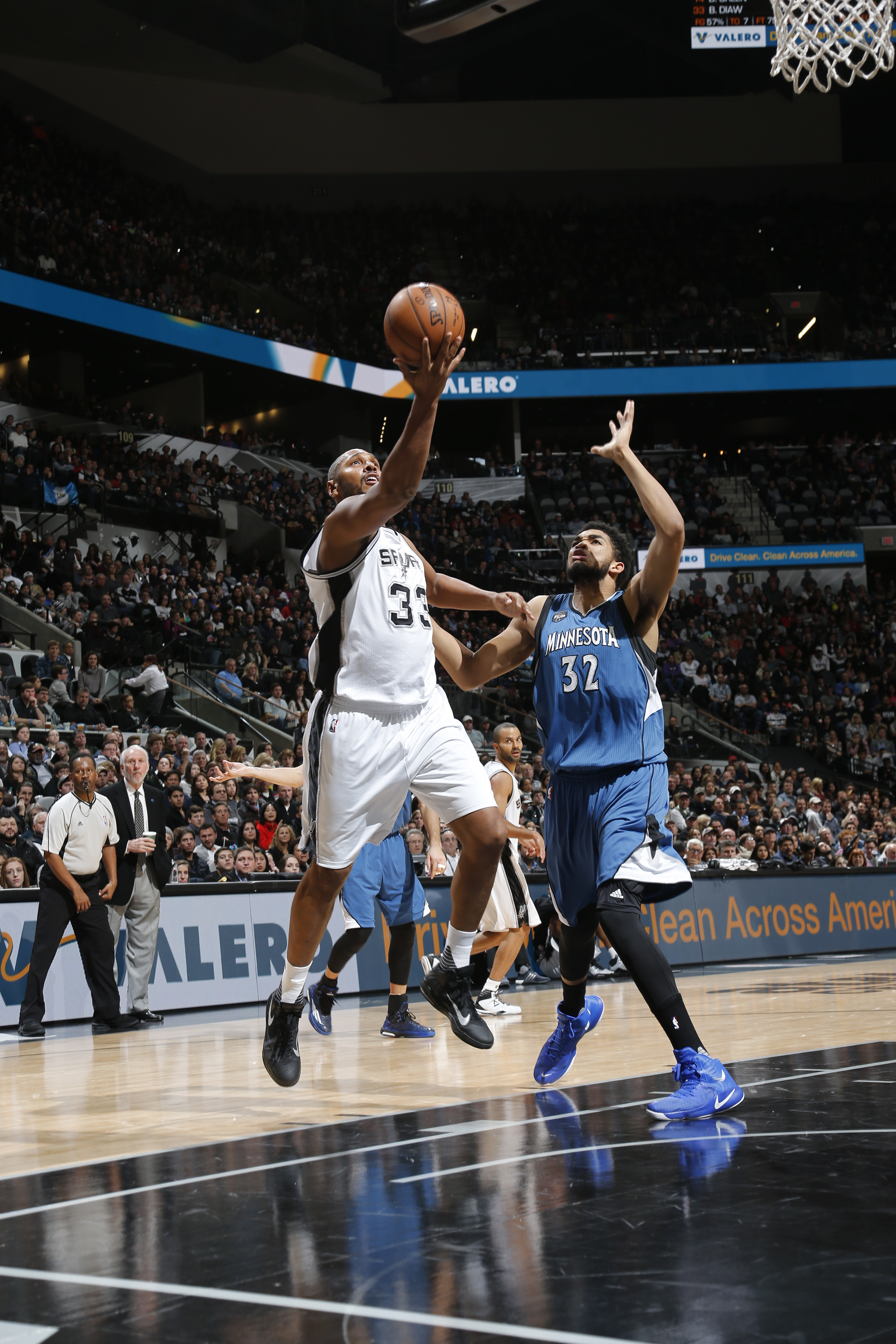 SAN ANTONIO, TX - DECEMBER 28:  Boris Diaw #33 of the San Antonio Spurs shoots the ball against Karl-Anthony Towns #32 of the Minnesota Timberwolves on December 28, 2015 at the AT&T Center in San Antonio, Texas.