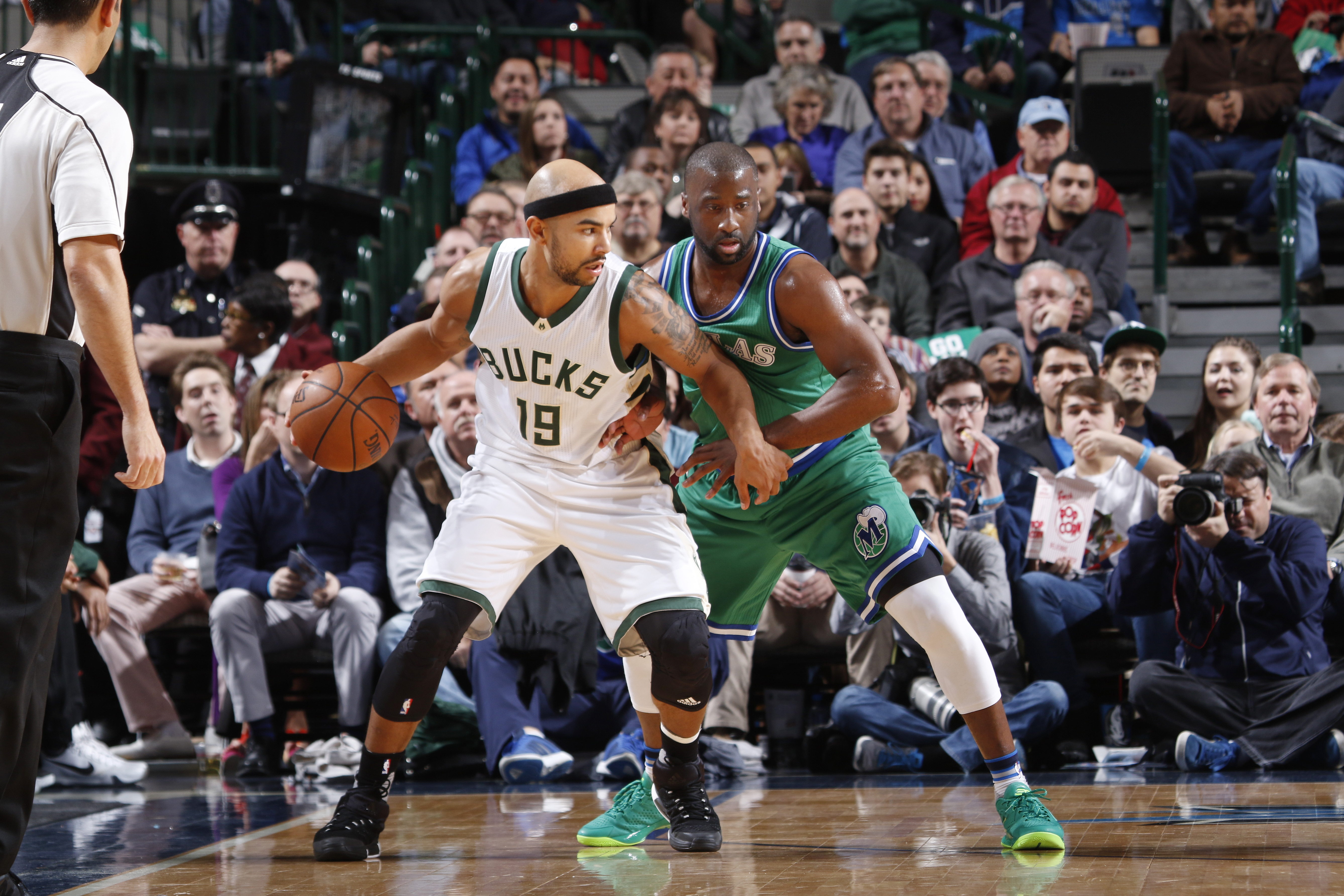DALLAS, TX - DECEMBER 28: Jerryd Bayless #19 of the Milwaukee Bucks handles the ball against Raymond Felton #2 of the Dallas Mavericks on December 28, 2015 at the American Airlines Center in Dallas, Texas. (Photo by Glenn James/NBAE via Getty Images)