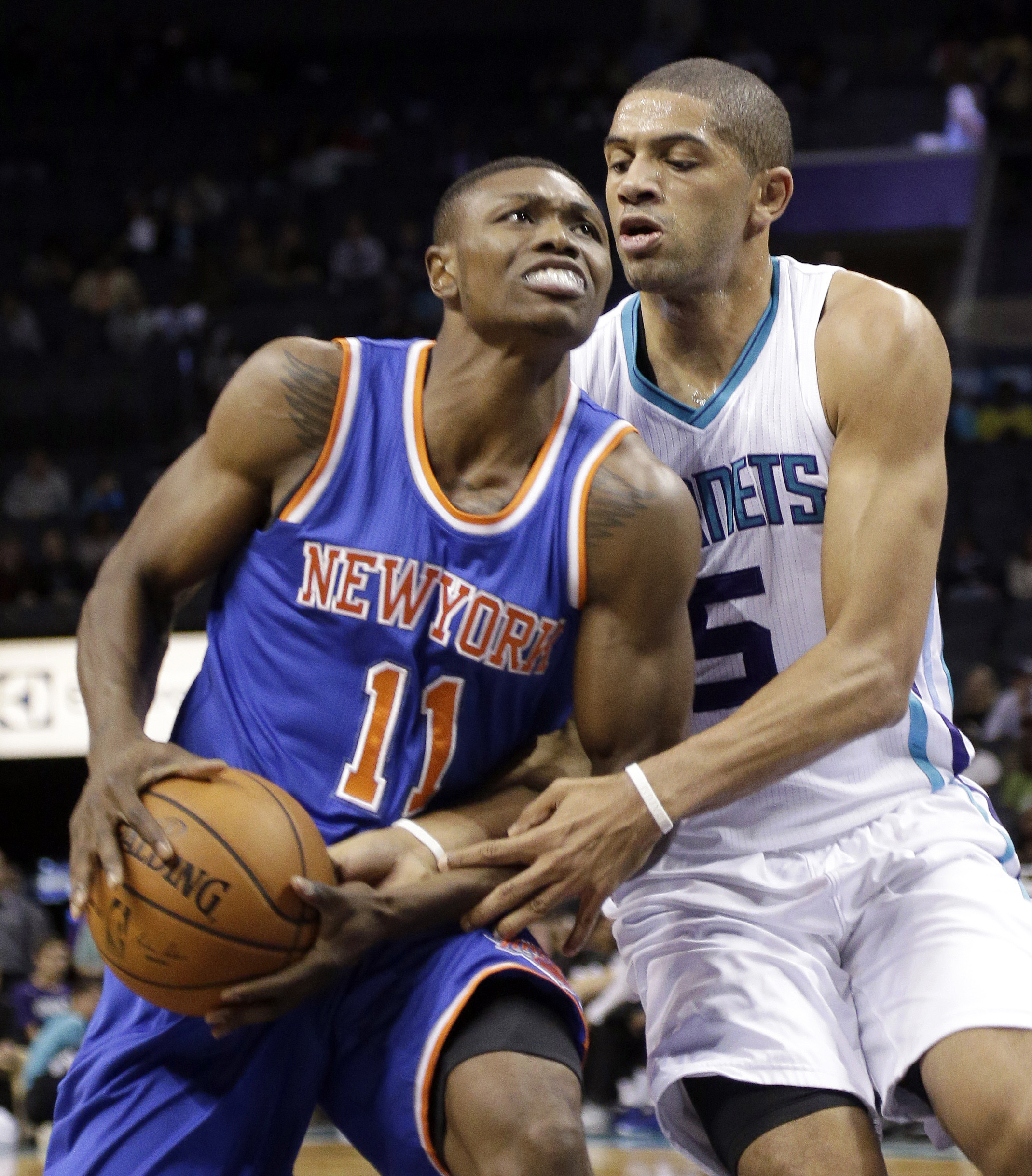 FILE - In this Oct. 17, 2015, file photo, New York Knicks' Cleanthony Early (11) is fouled by Charlotte Hornets' Nicolas Batum (5) in the first half of an NBA preseason basketball game in Charlotte, N.C. Law enforcement officials say Early was shot in the