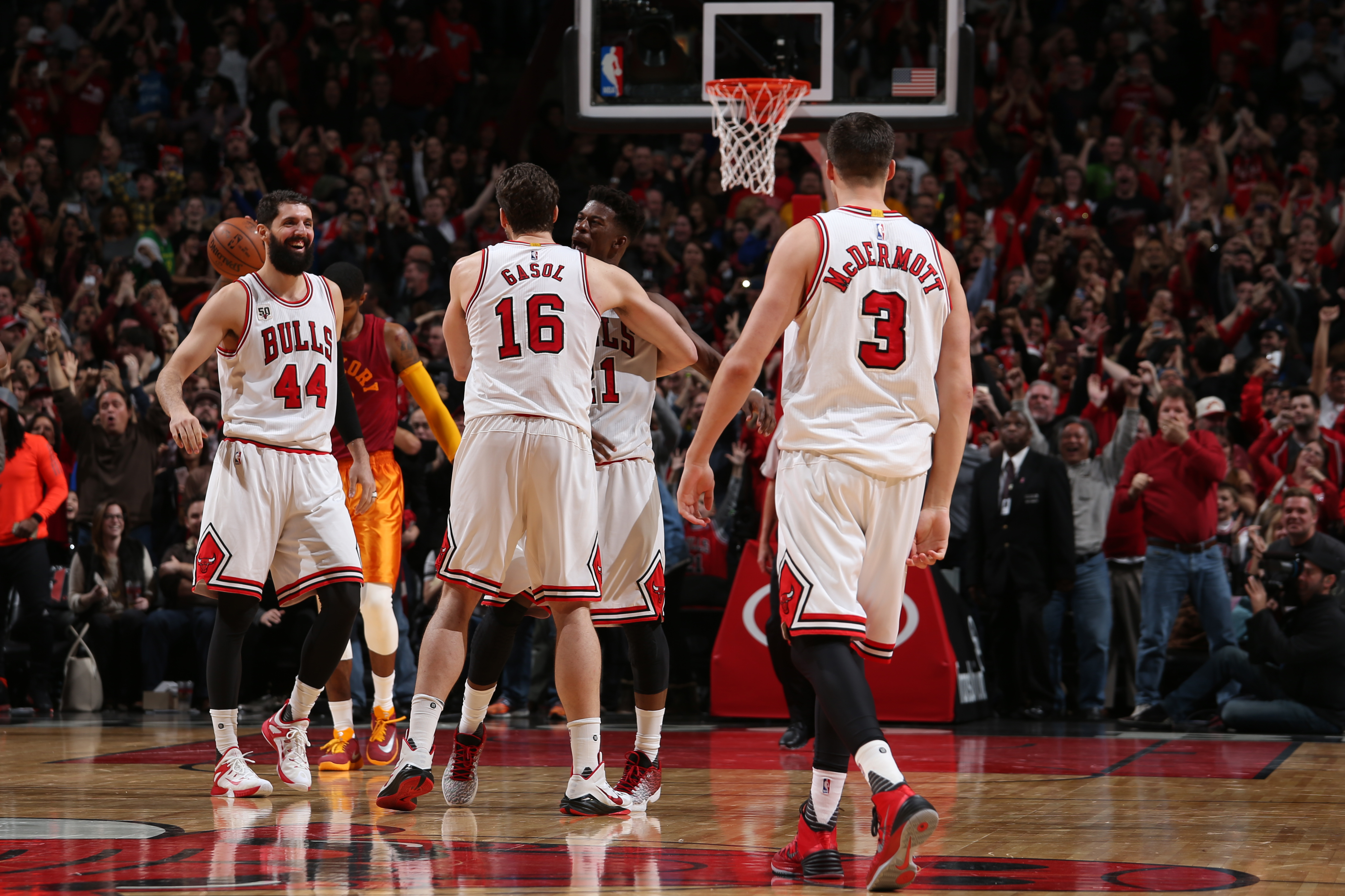 CHICAGO, IL - DECEMBER 30:  Pau Gasol #16 of the Chicago Bulls hugs Jimmy Butler #21 of the Chicago Bulls after scoring the go ahead basket in overtime against the Indiana Pacers on December 30, 2015 at the United Center in Chicago, Illinois. (Photo by Ga