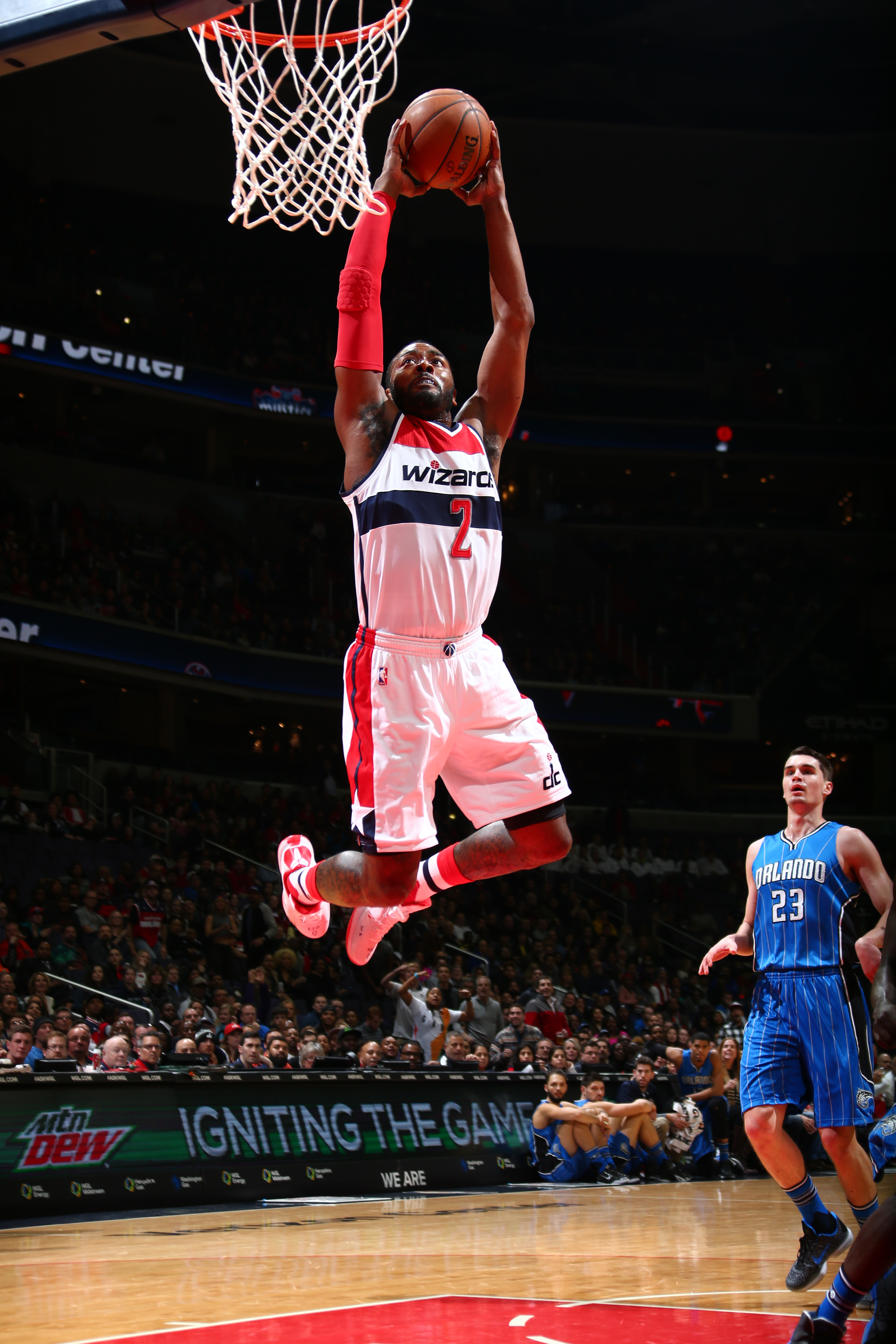 WASHINGTON, DC - JANUARY 1: John Wall #2 of the Washington Wizards goes for the dunk against the Orlando Magic during the game on January 1, 2016 at Verizon Center in Washington, District of Columbia. (Photo by Ned Dishman/NBAE via Getty Images)