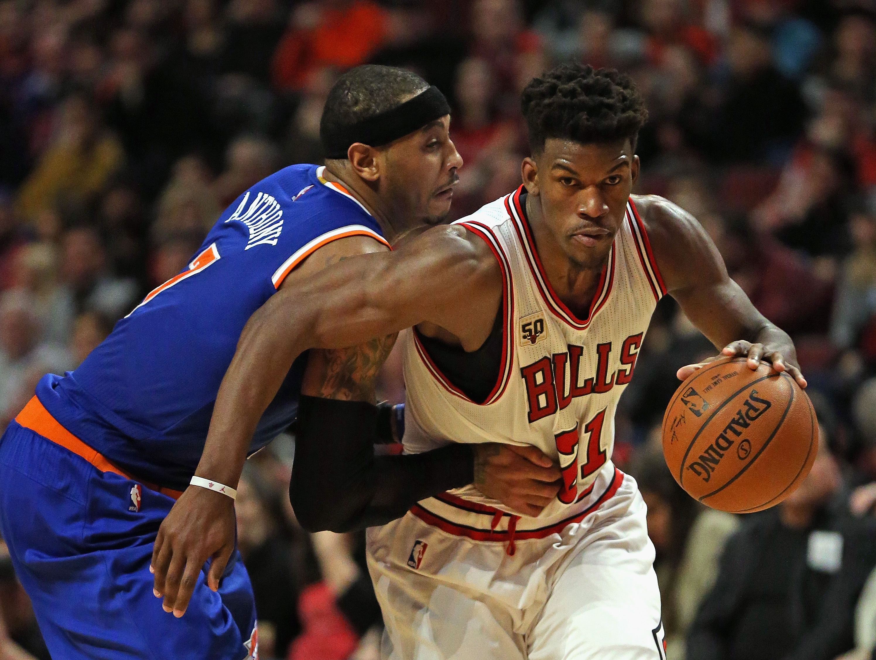 CHICAGO, IL - JANUARY 01:  Jimmy Butler #21 of the Chicago Bulls drives past Carmelo Anthony #7 of the New York Knicks at the United Center on January 1, 2016 in Chicago, Illinois. The Bulls defeated the Knicks 108-81. (Photo by Jonathan Daniel/Getty Imag