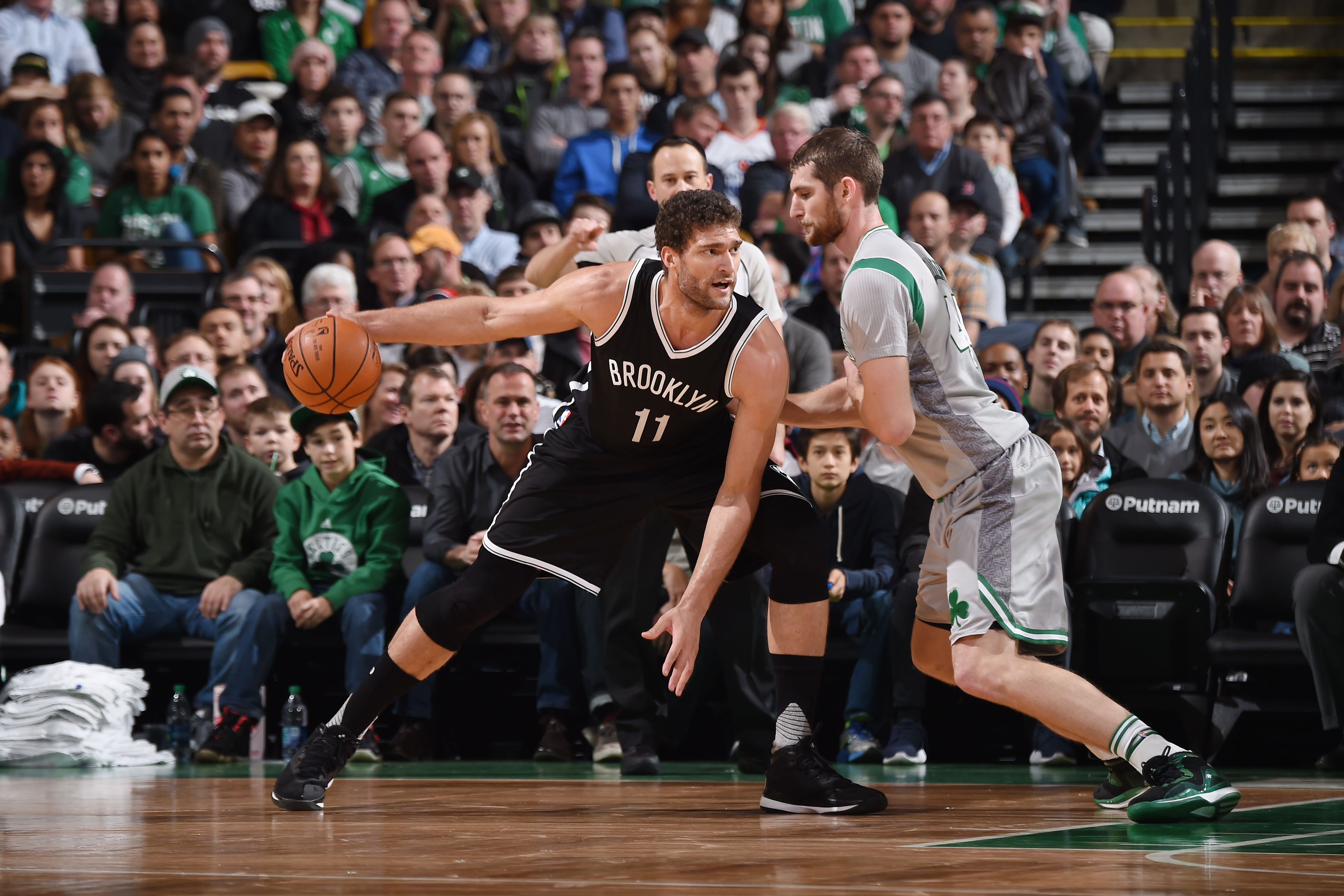 BOSTON, MA - JANUARY 2:  Brook Lopez #11 of the Brooklyn Nets posts up against Tyler Zeller #44 of the Boston Celtics on January 2, 2016 at the TD Garden in Boston, Massachusetts.  (Photo by Brian Babineau/NBAE via Getty Images)