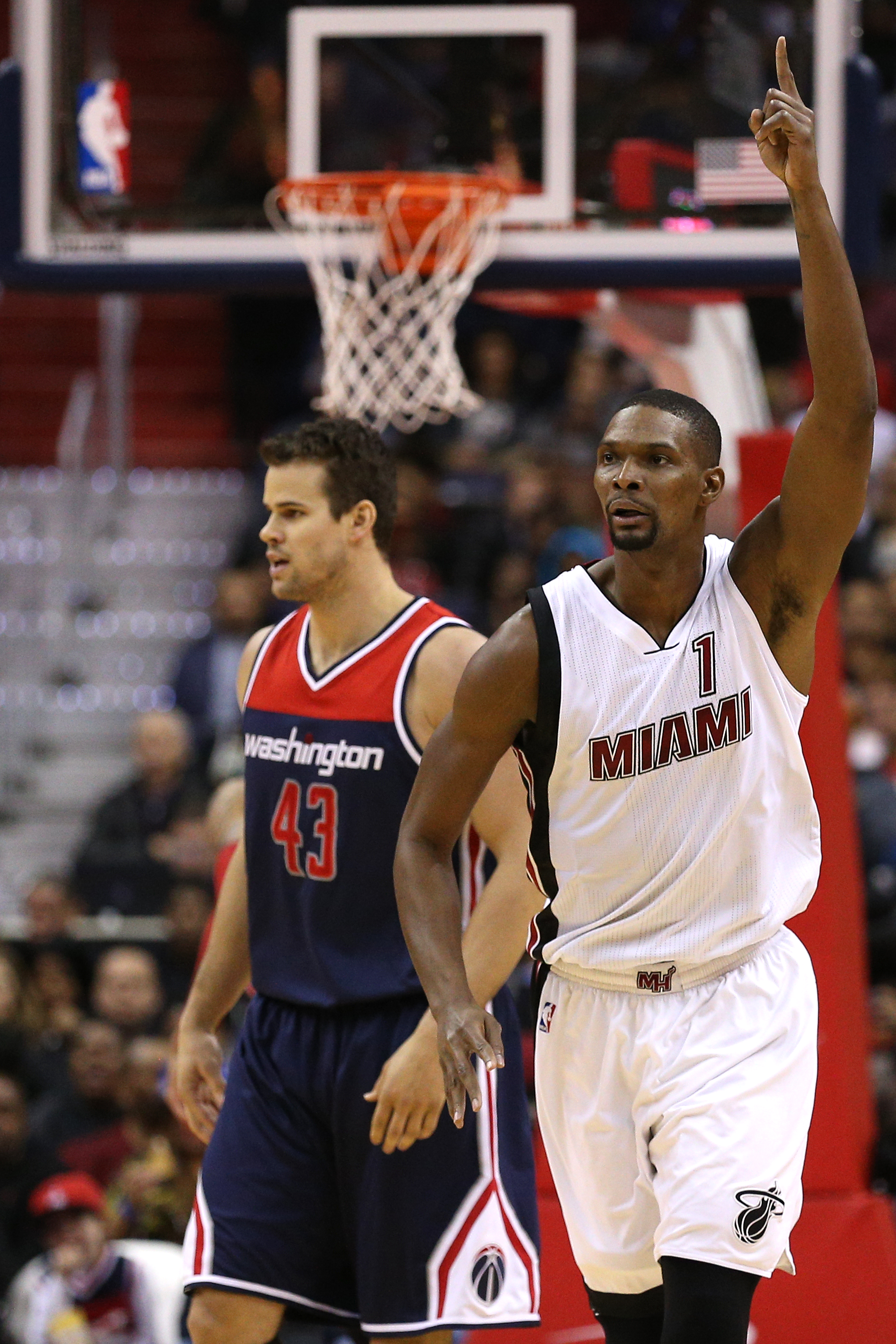 WASHINGTON, DC - JANUARY 03: Chris Bosh #1 of the Miami Heat celebrates after scoring against the Washington Wizards during the second half at Verizon Center on January 3, 2016 in Washington, DC. The Miami Heat won, 97-75. (Photo by Patrick Smith/Getty Im