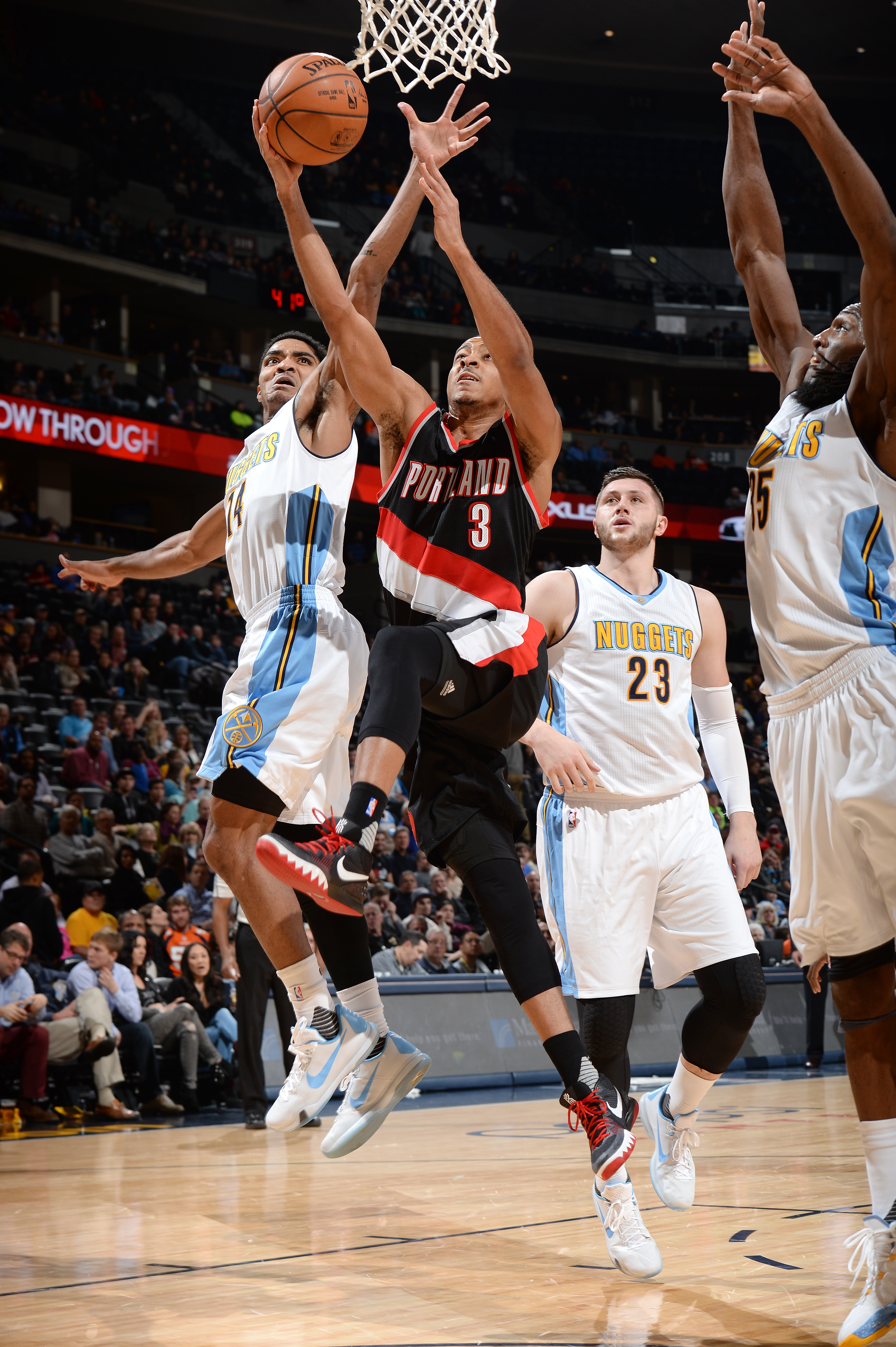 DENVER, CO - JANUARY 3: C.J. McCollum #3 of the Portland Trail Blazers goes to the basket during the game against the Denver Nuggets on January 3, 2016 at the Pepsi Center in Denver, Colorado. (Photo by Garrett Ellwood/NBAE via Getty Images)