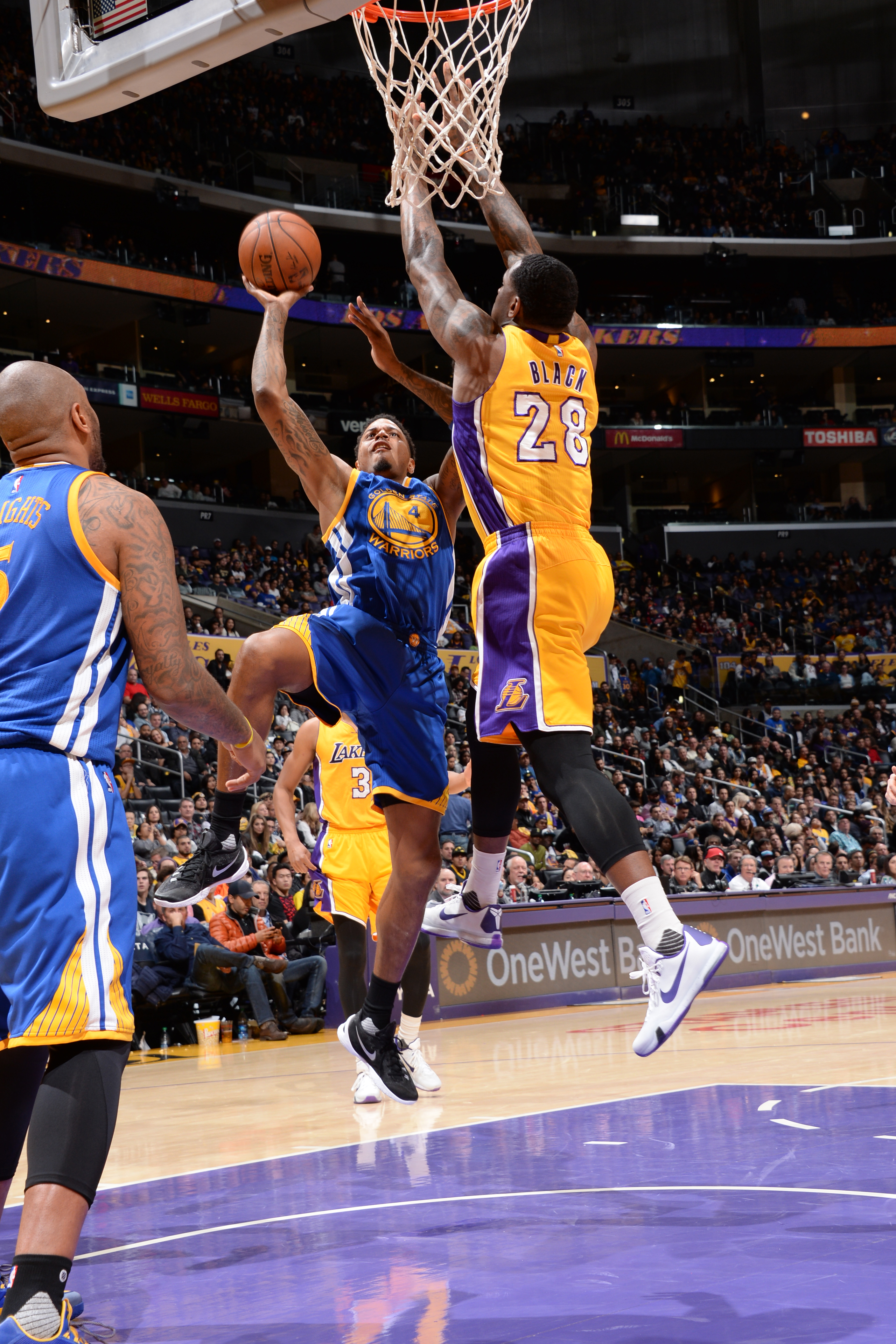 LOS ANGELES, CA - JANUARY 5: Brandon Rush #4 of the Golden State Warriors goes for the lay up against Tarik Black #28 of the Los Angeles Lakers during the game on January 5, 2016 at STAPLES Center in Los Angeles, California. (Photo by Andrew Bernstein/NBA