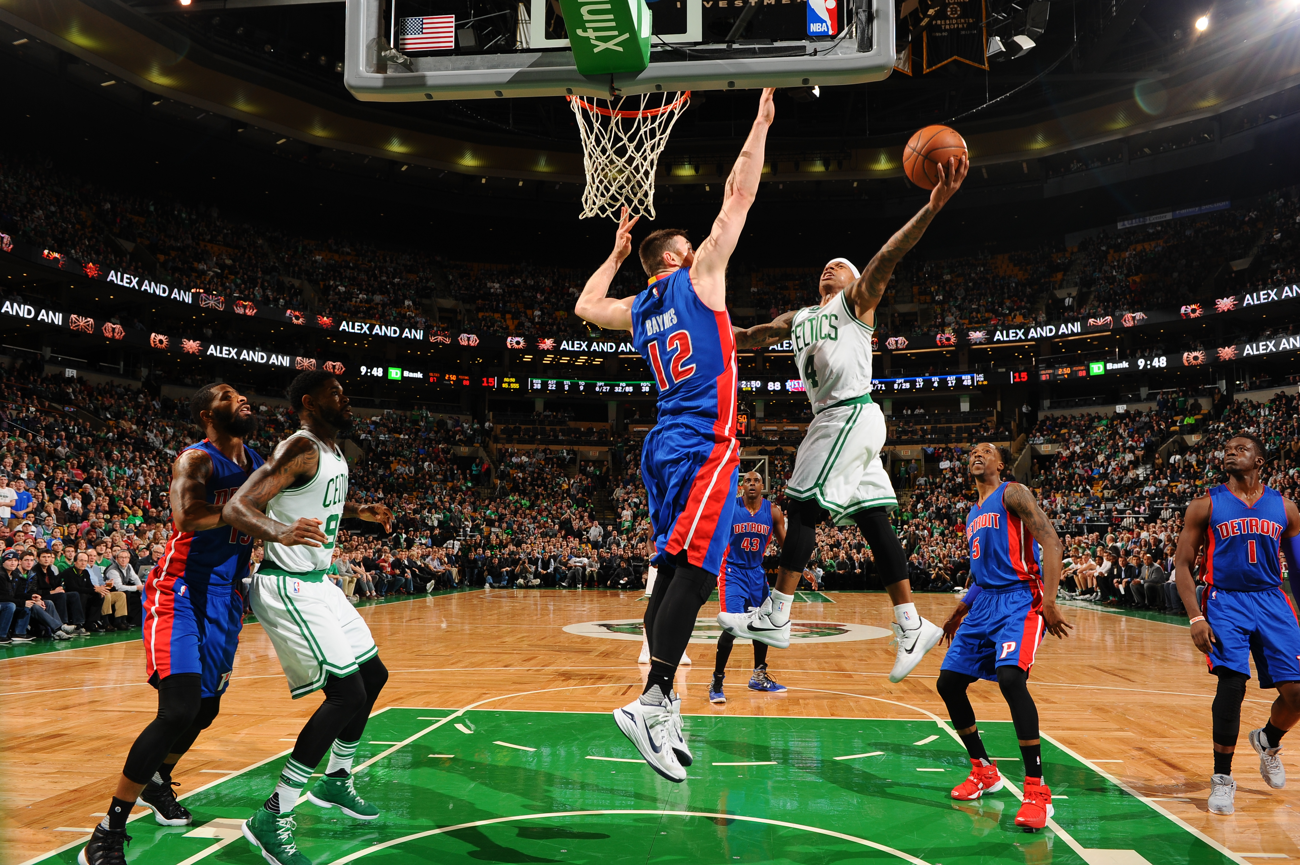 BOSTON, MA - JANUARY 6: Isaiah Thomas #4 of the Boston Celtics goes for the lay up against Aron Baynes #12 of the Detroit Pistons during the game on January 6, 2016 at TD Garden in Boston, Massachusetts. (Photo by Brian Babineau/NBAE via Getty Images)