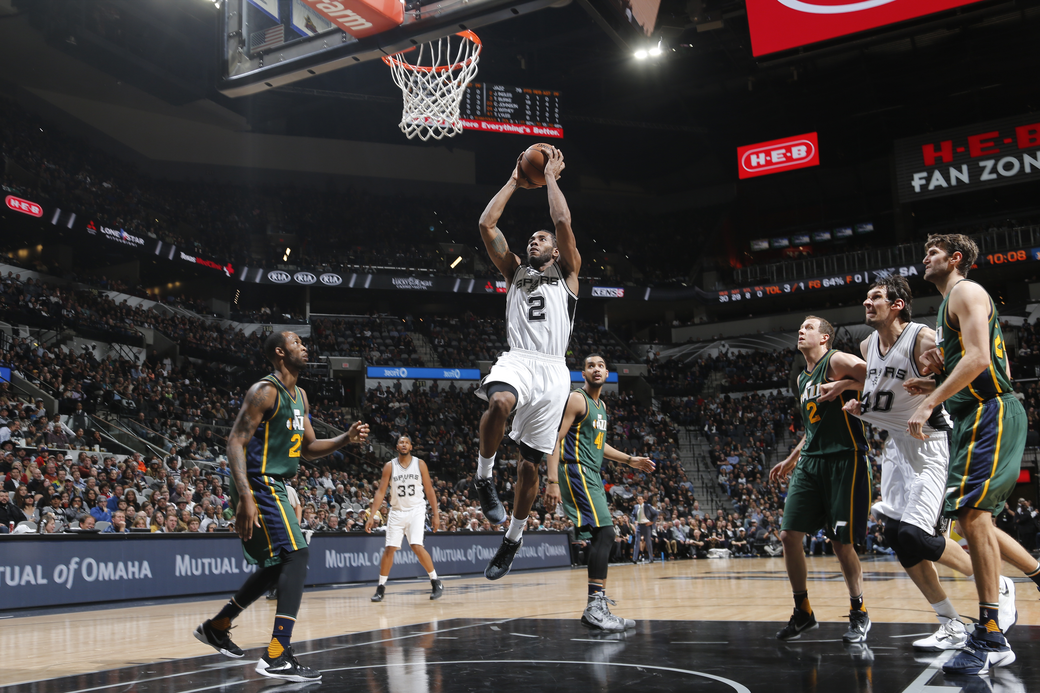 SAN ANTONIO, TX - JANUARY 6:  Kawhi Leonard #2 of the San Antonio Spurs goes up for a dunk against the Utah Jazz on January 6, 2016 at the AT&T Center in San Antonio, Texas.