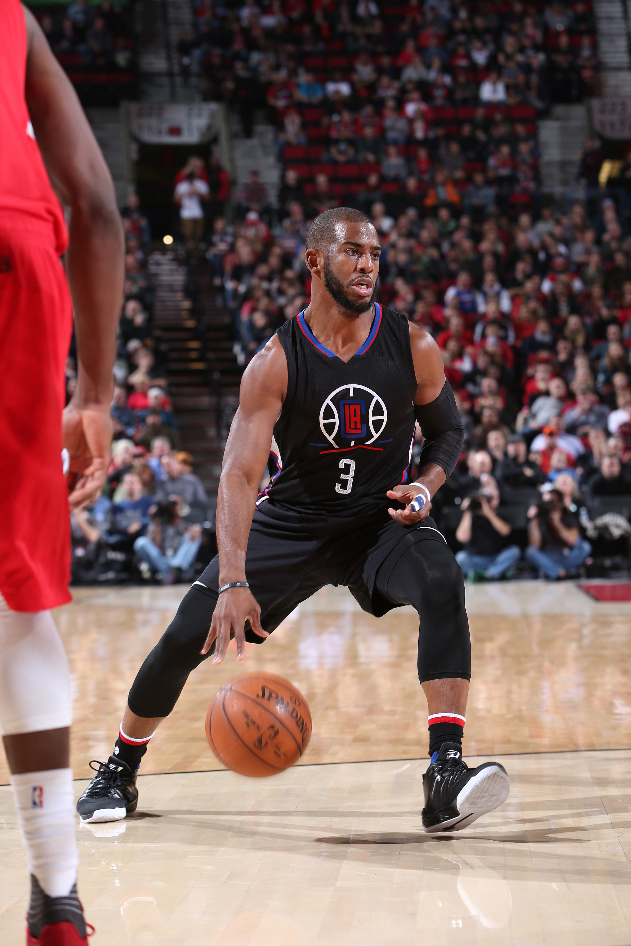 PORTLAND, OR - JANUARY 6: Chris Paul #3 of the Los Angeles Clippers handles the ball during the game against the Portland Trail Blazers on January 6, 2016 at the Moda Center in Portland, Oregon. (Photo by Sam Forencich/NBAE via Getty Images)