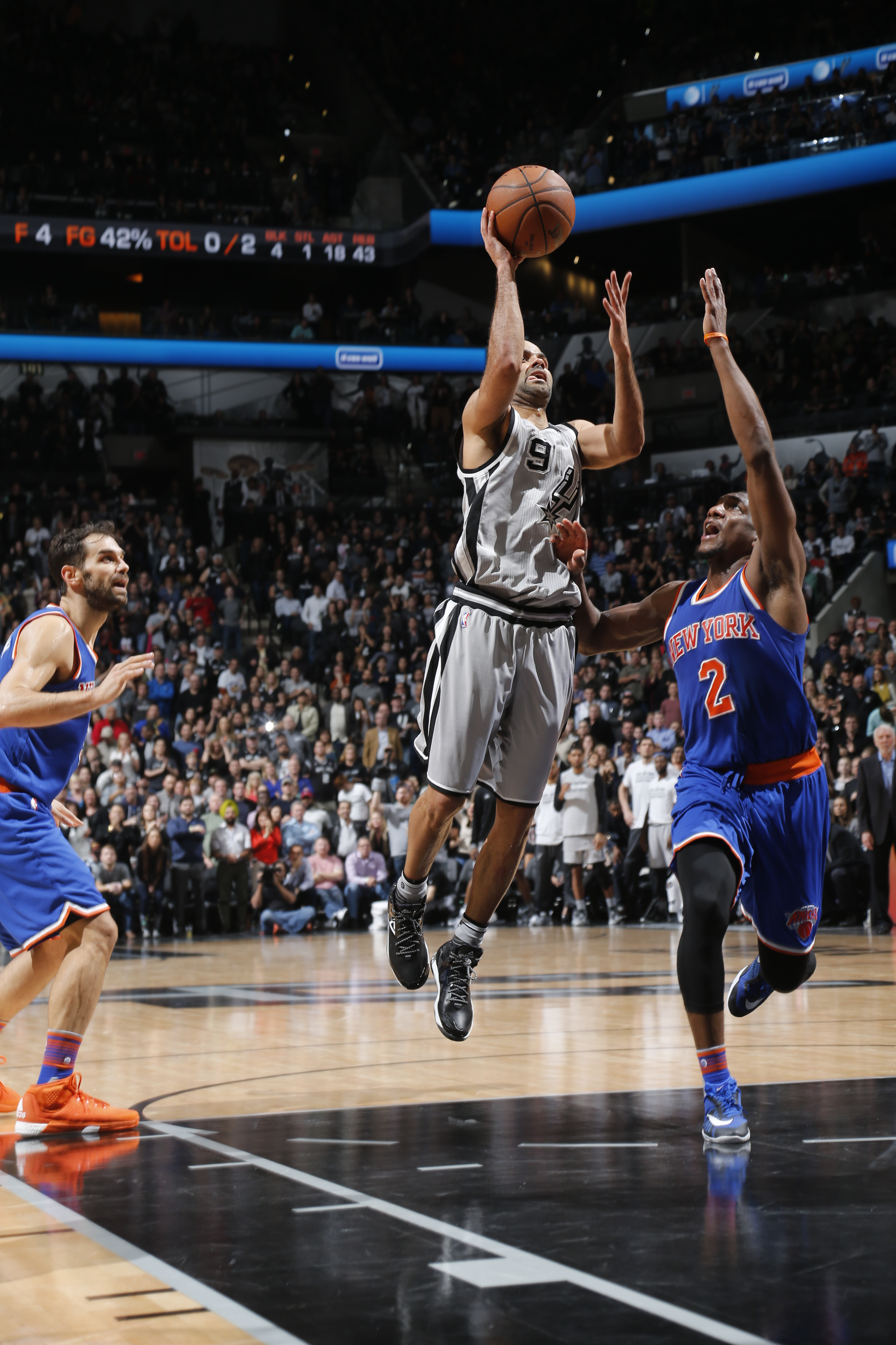 SAN ANTONIO, TX - JANUARY 8:  Tony Parker #9 of the San Antonio Spurs goes to the basket against Langston Galloway #2 of the New York Knicks on December 8, 2016 at the AT&T Center in San Antonio, Texas.