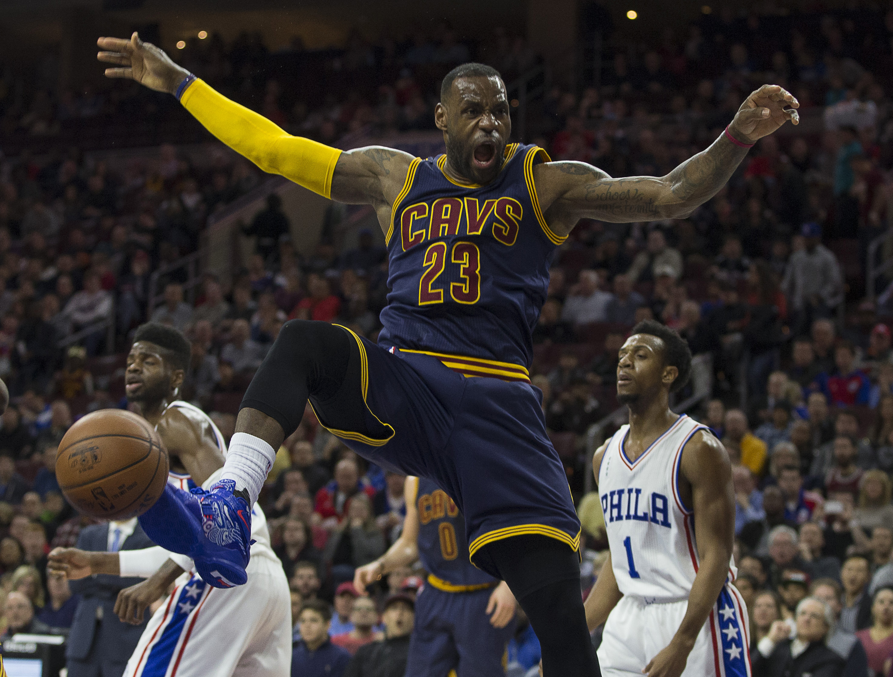 PHILADELPHIA, PA - JANUARY 10: LeBron James #23 of the Cleveland Cavaliers reacts after a dunk against the Philadelphia 76ers on January 10, 2016 at the Wells Fargo Center in Philadelphia, Pennsylvania. (Photo by Mitchell Leff/Getty Images)