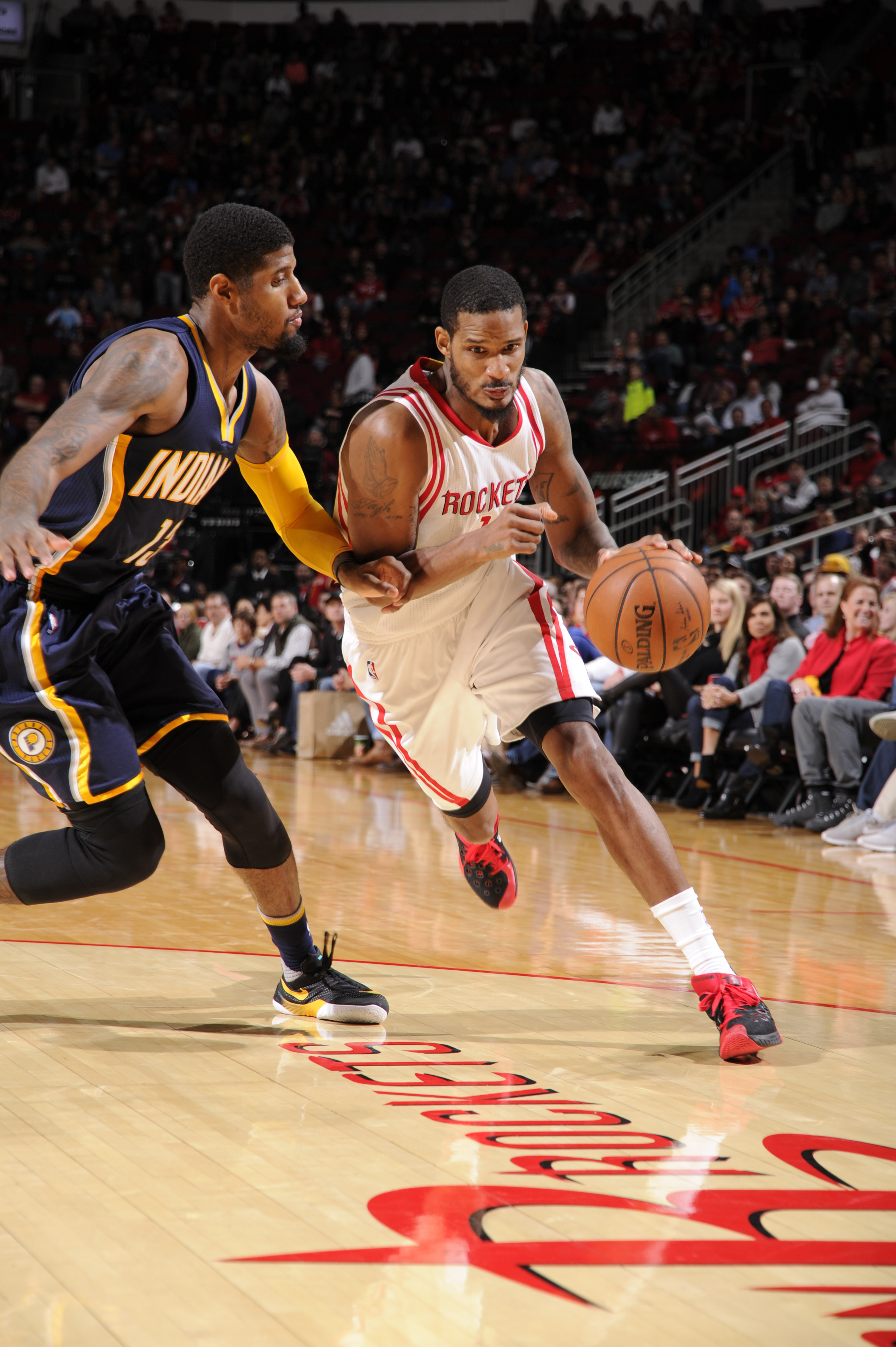 HOUSTON, TX - JANUARY 10: Trevor Ariza #1 of the Houston Rockets drives to the basket against the Indiana Pacers on January 10, 2016 at the Toyota Center in Houston, Texas. (Photo by Bill Baptist/NBAE via Getty Images)