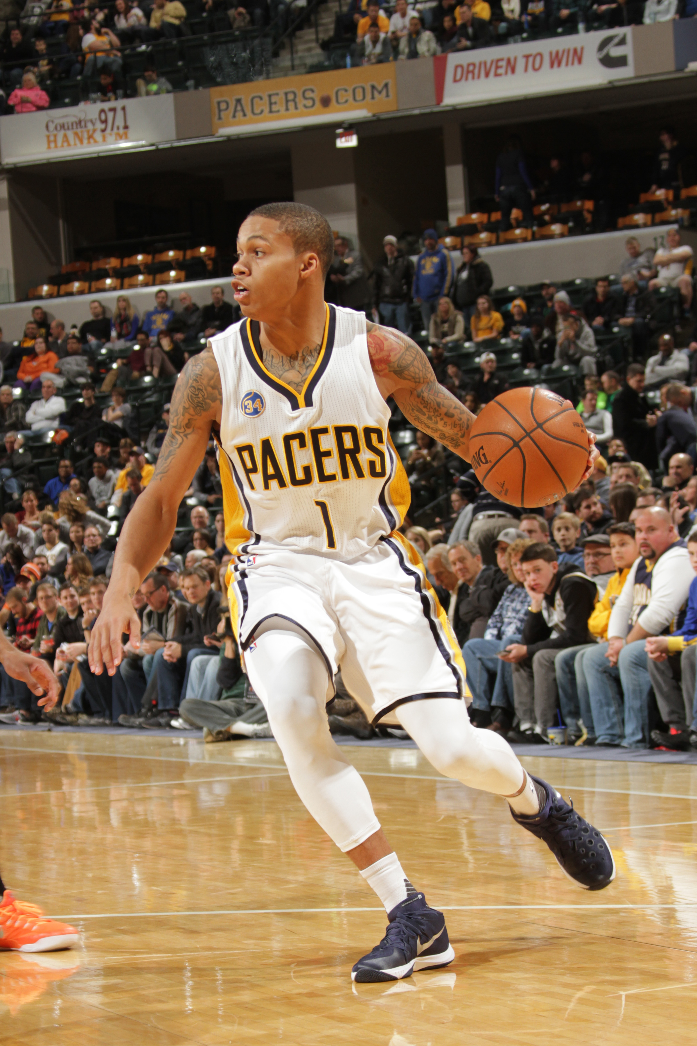 INDIANAPOLIS, IN - JANUARY 12: Joe Young #1 of the Indiana Pacers handles the ball against the Phoenix Suns on January 12, 2016 at Bankers Life Fieldhouse in Indianapolis, Indiana. (Photo by Ron Hoskins/NBAE via Getty Images)