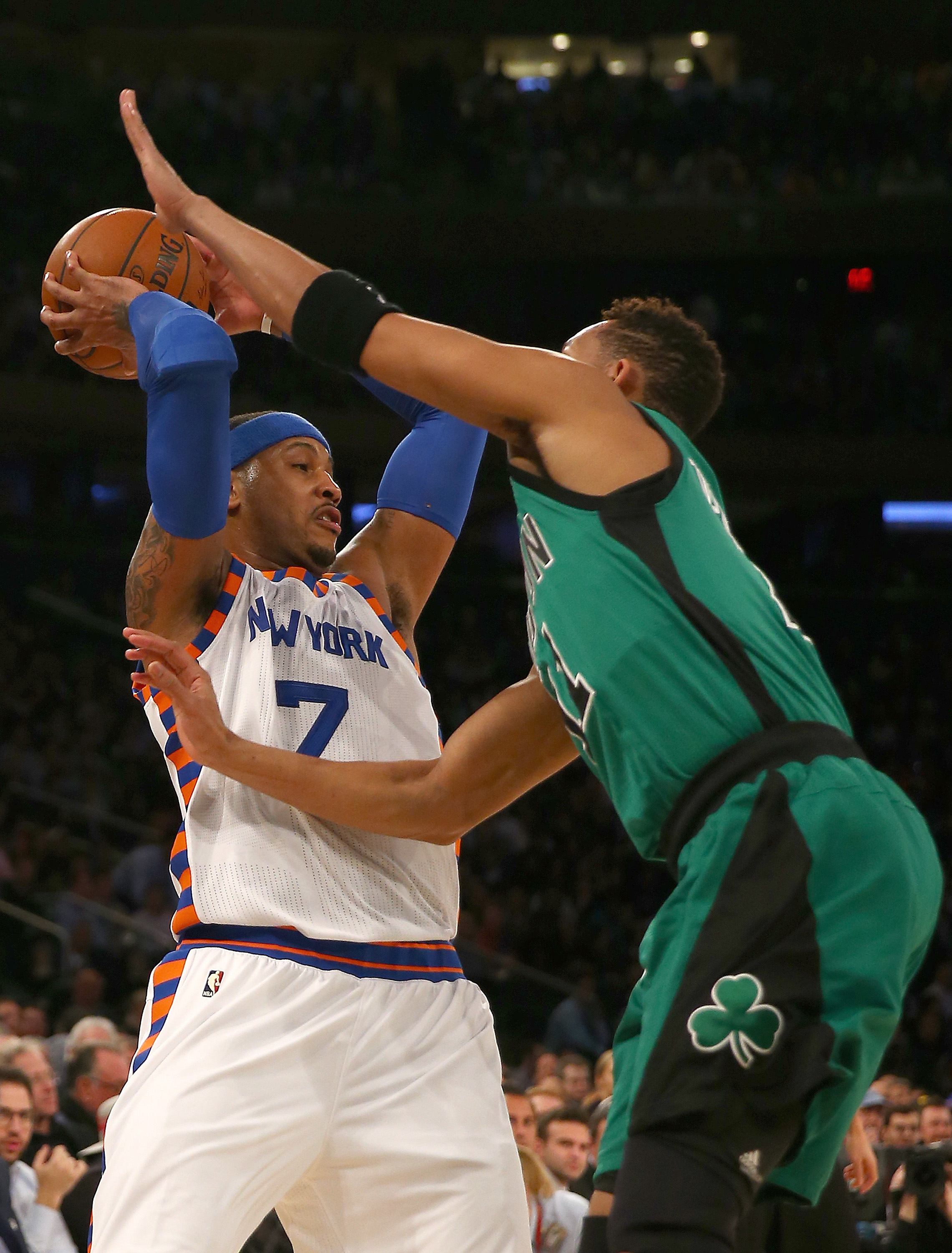 NEW YORK, NY - JANUARY 12:  Carmelo Anthony #7 of the New York Knicks tries to get around Evan Turner #11 of the Boston Celtics in the first half at Madison Square Garden on January 12, 2016 in New York City. (Photo by Elsa/Getty Images)
