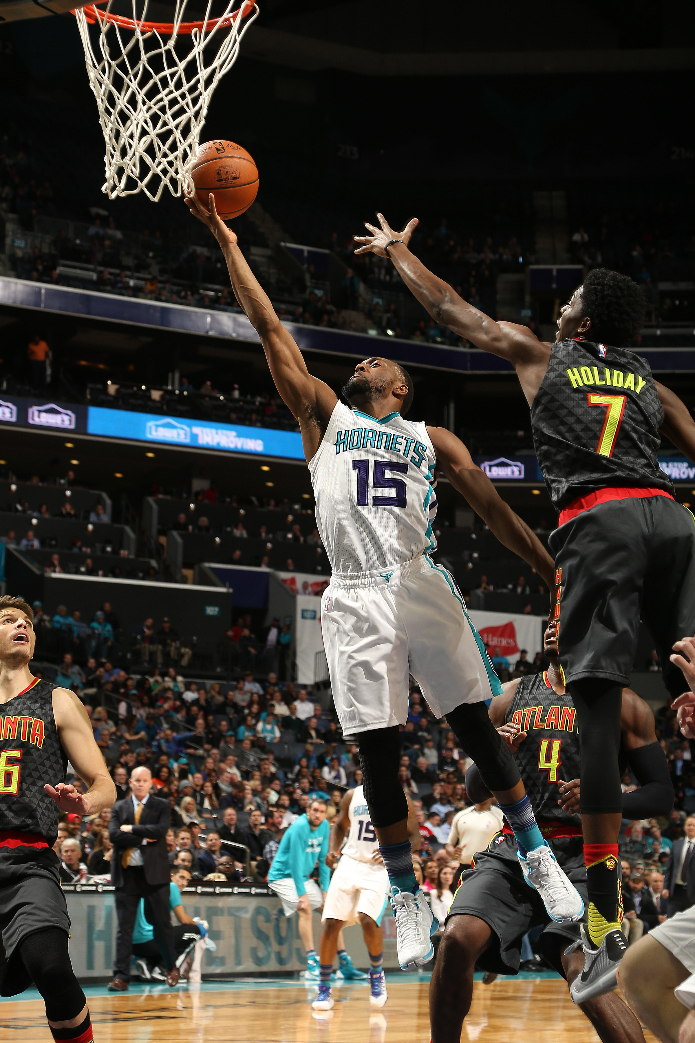 CHARLOTTE, NC - JANUARY 13: Kemba Walker #15 of the Charlotte Hornets shoots the ball against the Atlanta Hawks on January 13, 2016 at Time Warner Cable Arena in Charlotte, North Carolina. (Photo by Kent Smith/NBAE via Getty Images)
