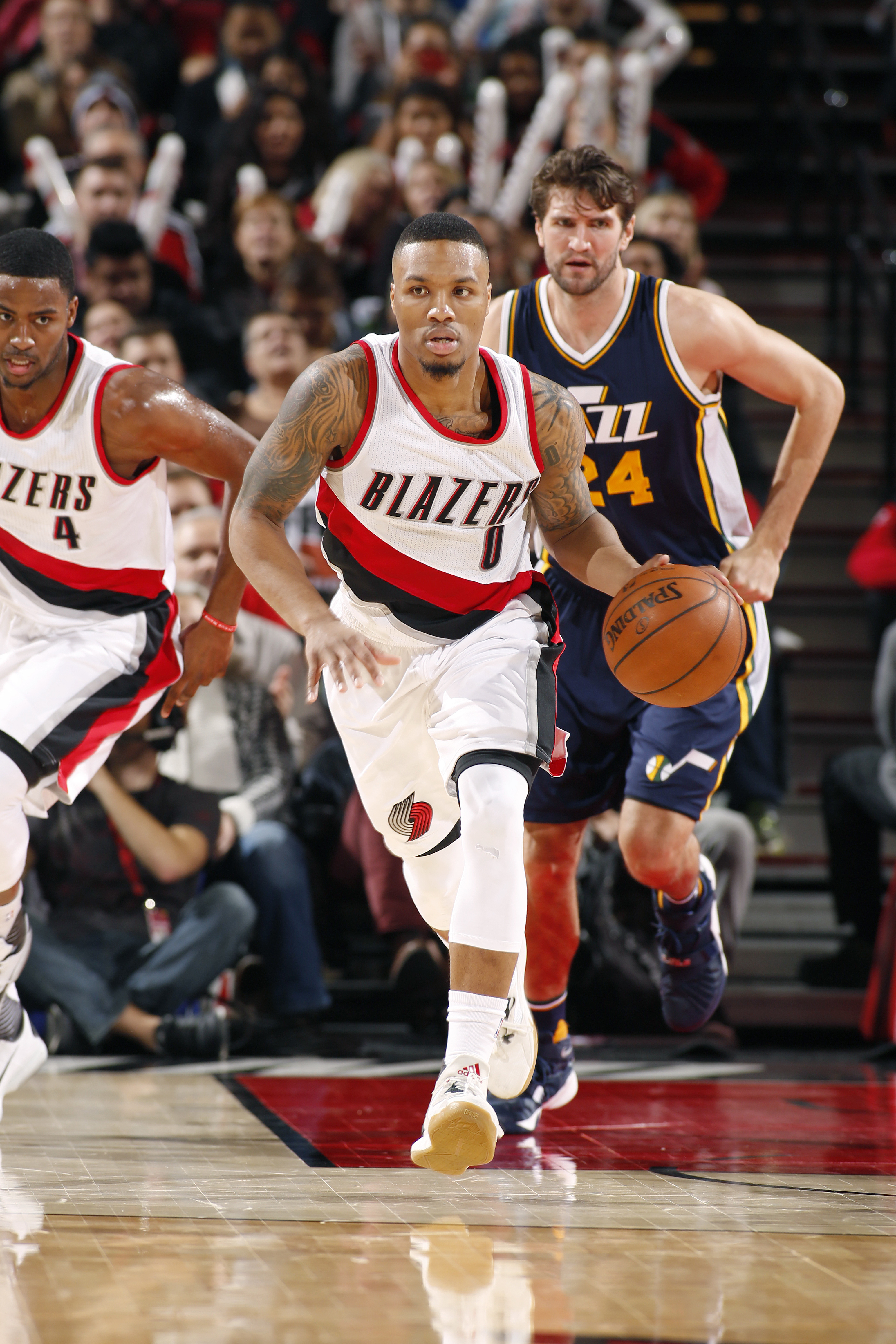 PORTLAND, OR - JANUARY 13: Damian Lillard #0 of the Portland Trail Blazers handles the ball during the game against the Utah Jazz on January 13, 2016 at the Moda Center in Portland, Oregon. (Photo by Cameron Browne/NBAE via Getty Images)